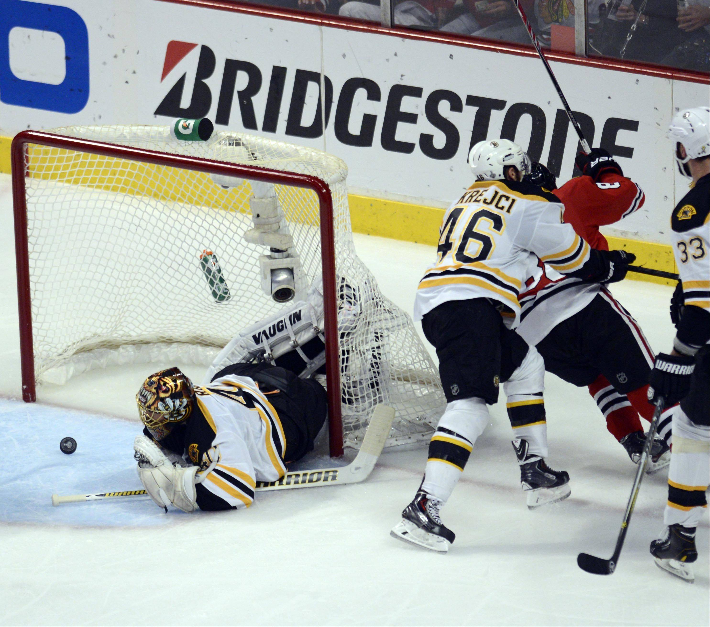 Boston Bruins center David Krejci pushes Chicago Blackhawks right wing Patrick Kane after his second period goal Saturday in Game 5 of the Stanley Cup Finals at the United Center in Chicago.