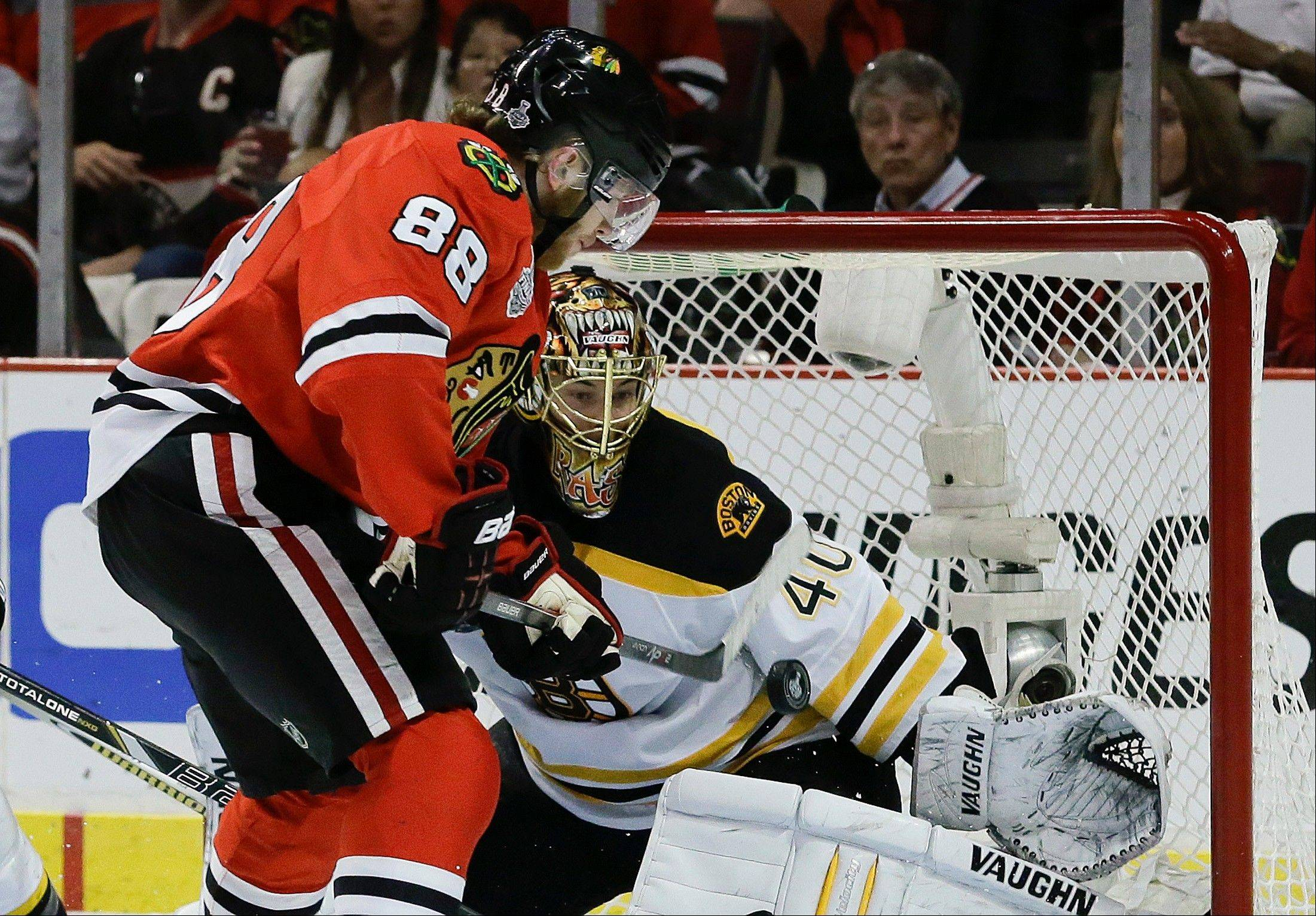 Chicago Blackhawks right wing Patrick Kane (88) scores against Boston Bruins goalie Tuukka Rask (40) in the second period during Game 5 of the NHL hockey Stanley Cup Finals, Saturday, June 22, 2013, in Chicago.