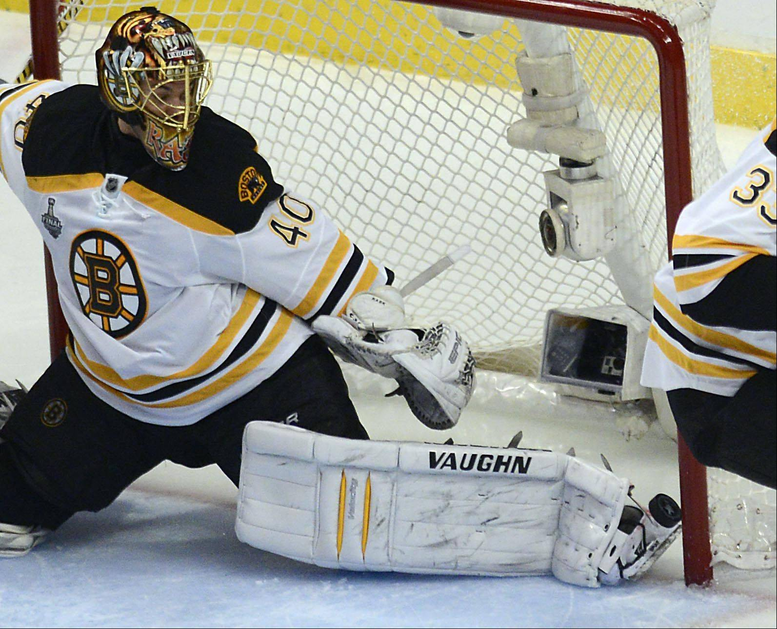 The puck get past Boston Bruins goalie Tuukka Rask on Chicago Blackhawks right wing Patrick Kane second goal Saturday in Game 5 of the Stanley Cup Finals at the United Center in Chicago.