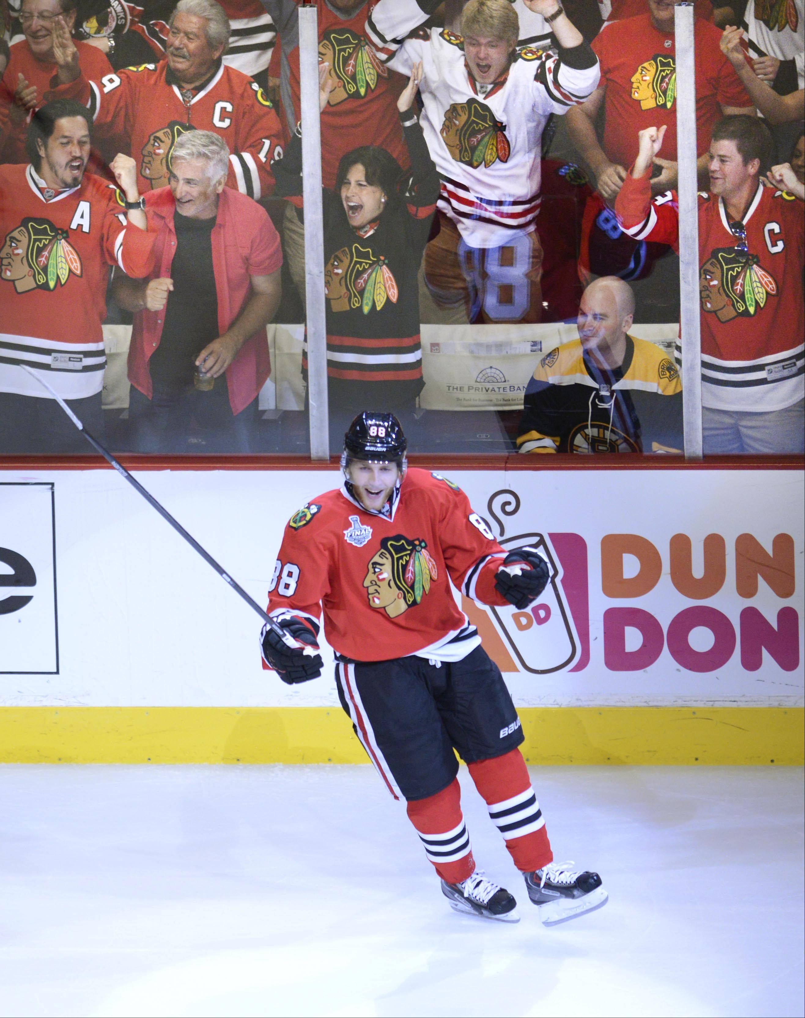 Blackhawks right wing Patrick Kane celebrates his first-period goal Saturday in Game 5 of the Stanley Cup Final at the United Center in Chicago.