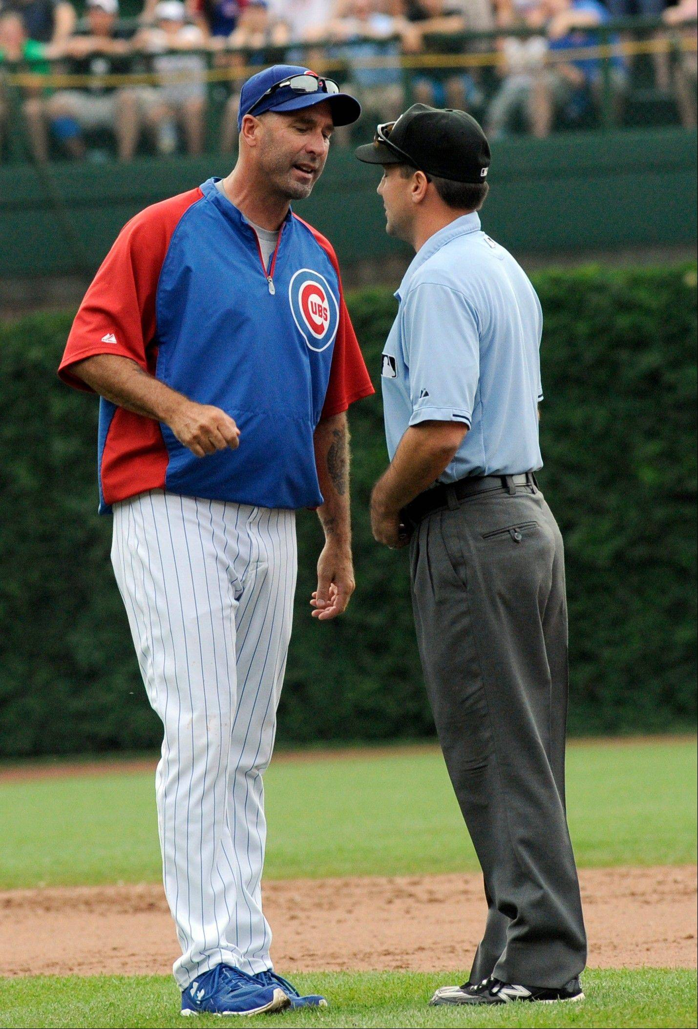 Manager Dale Sveum pleads his case after second-base umpire Clint Fagan called out the Cubs' Alfonso Soriano on a pickoff play in the eighth inning Saturday at Wrigley Field.