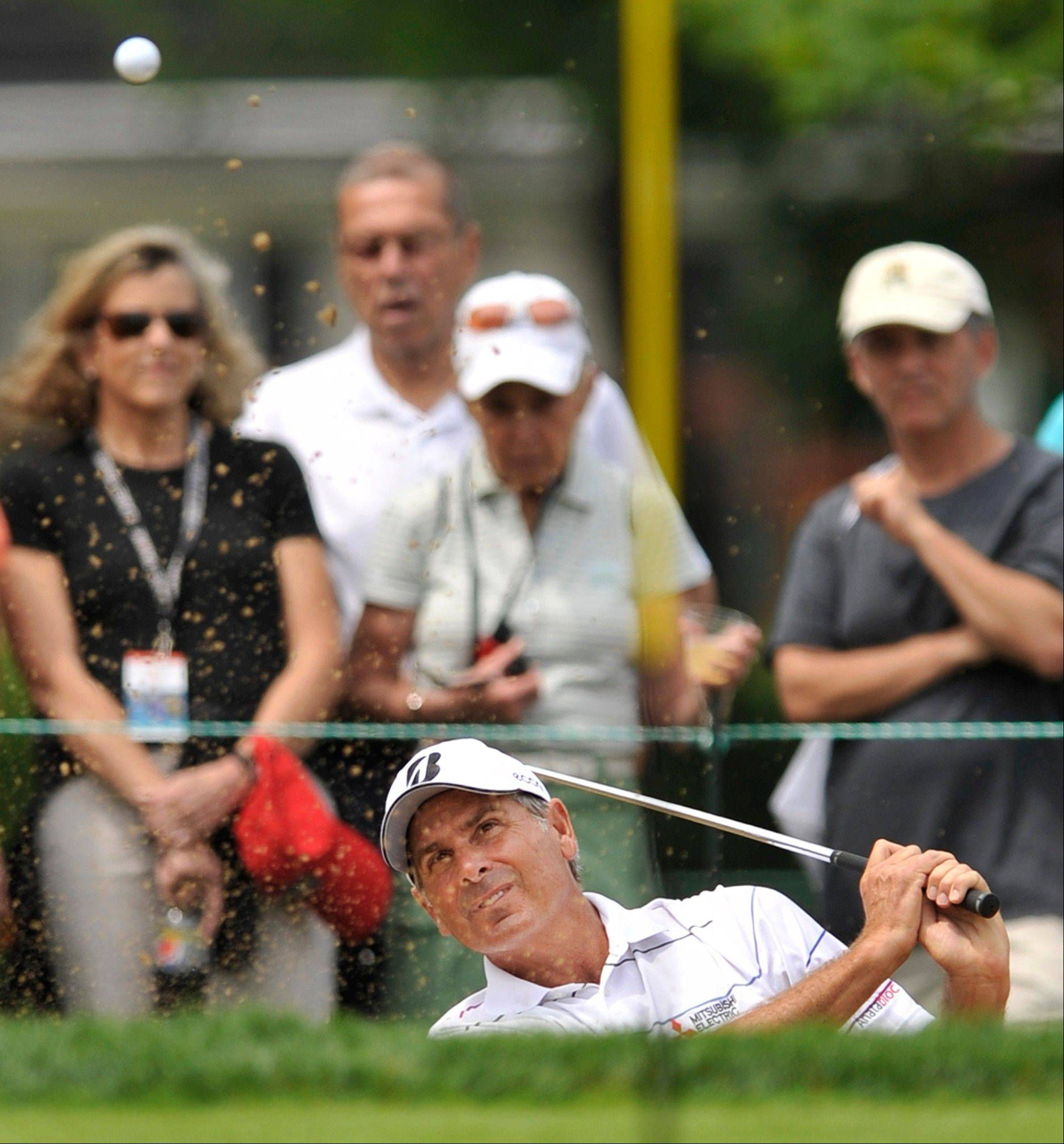 Fred Couples hits out of a bunker on the 12th hole during the second round of the Encompass Championship at North Shore County Club in Glenview on Saturday.