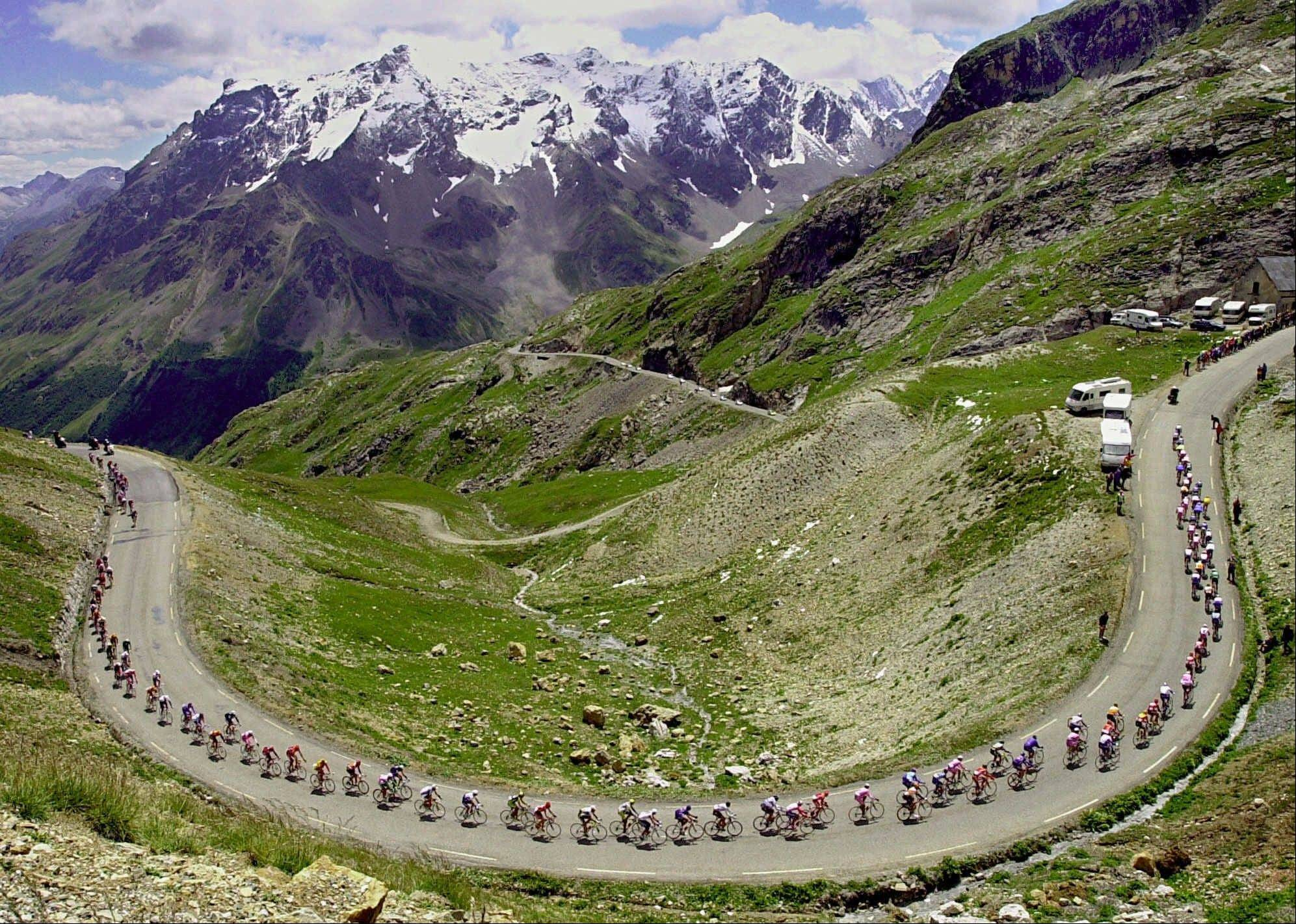 The pack climbs the Galibier pass during the 15th stage of the Tour de France in 2000.