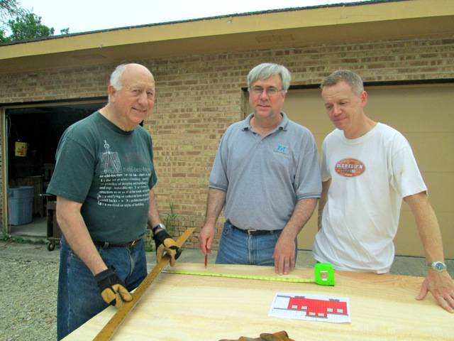 Core group of the League of Extraordinary Float Builders begin construction on the caboose they are making for the Glen Ellyn 4th of July Parade.  Left to right are Richard Winans, John Winans and Mike Bradley.  They have been building floats for the Glen Ellyn Historical Society for nine years.