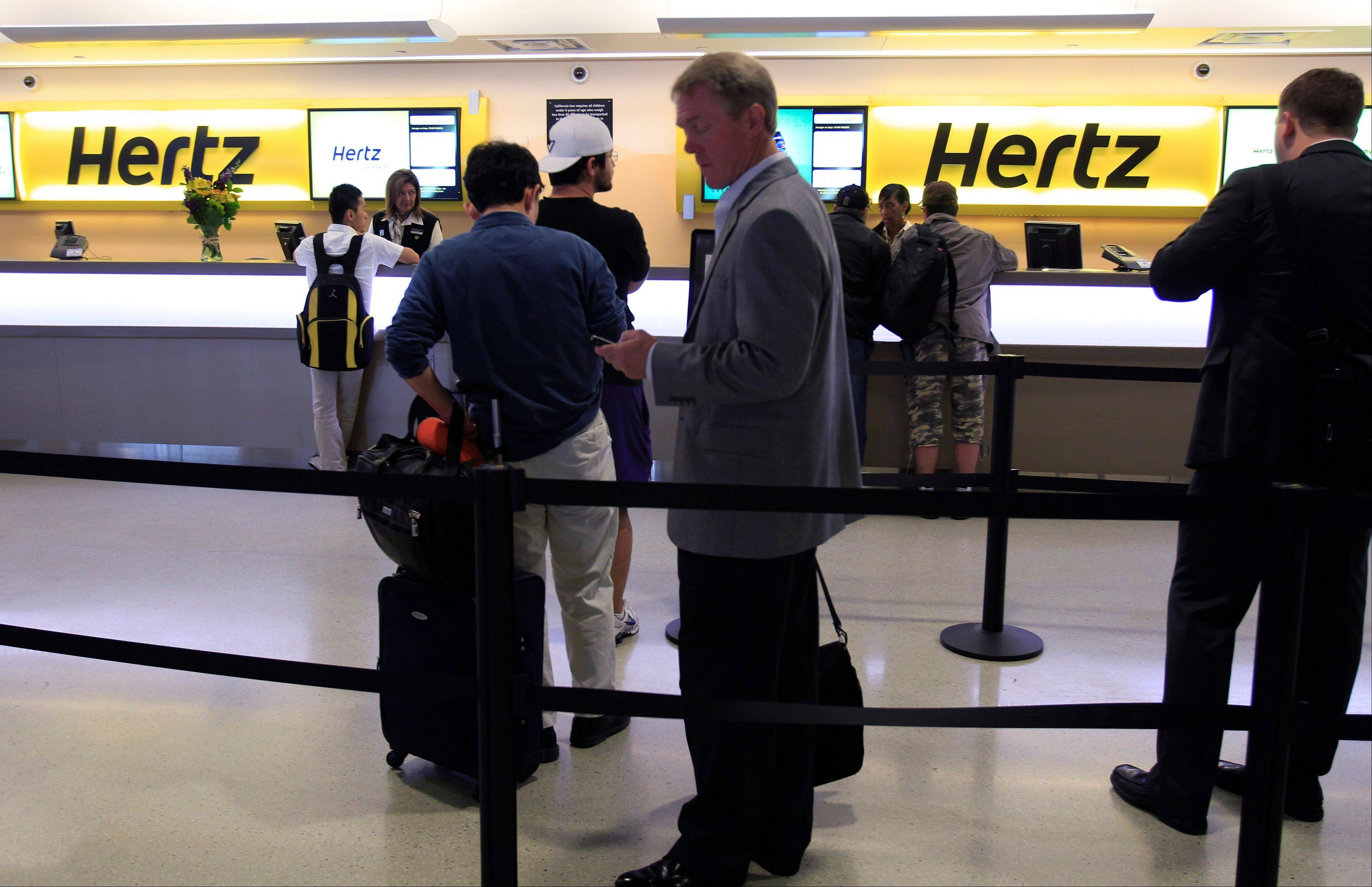 Customers wait in line at a Hertz rental car counter at San Jose International Airport in San Jose, Calif. Car rental agencies sometimes don�t have enough cars to meet the demand.