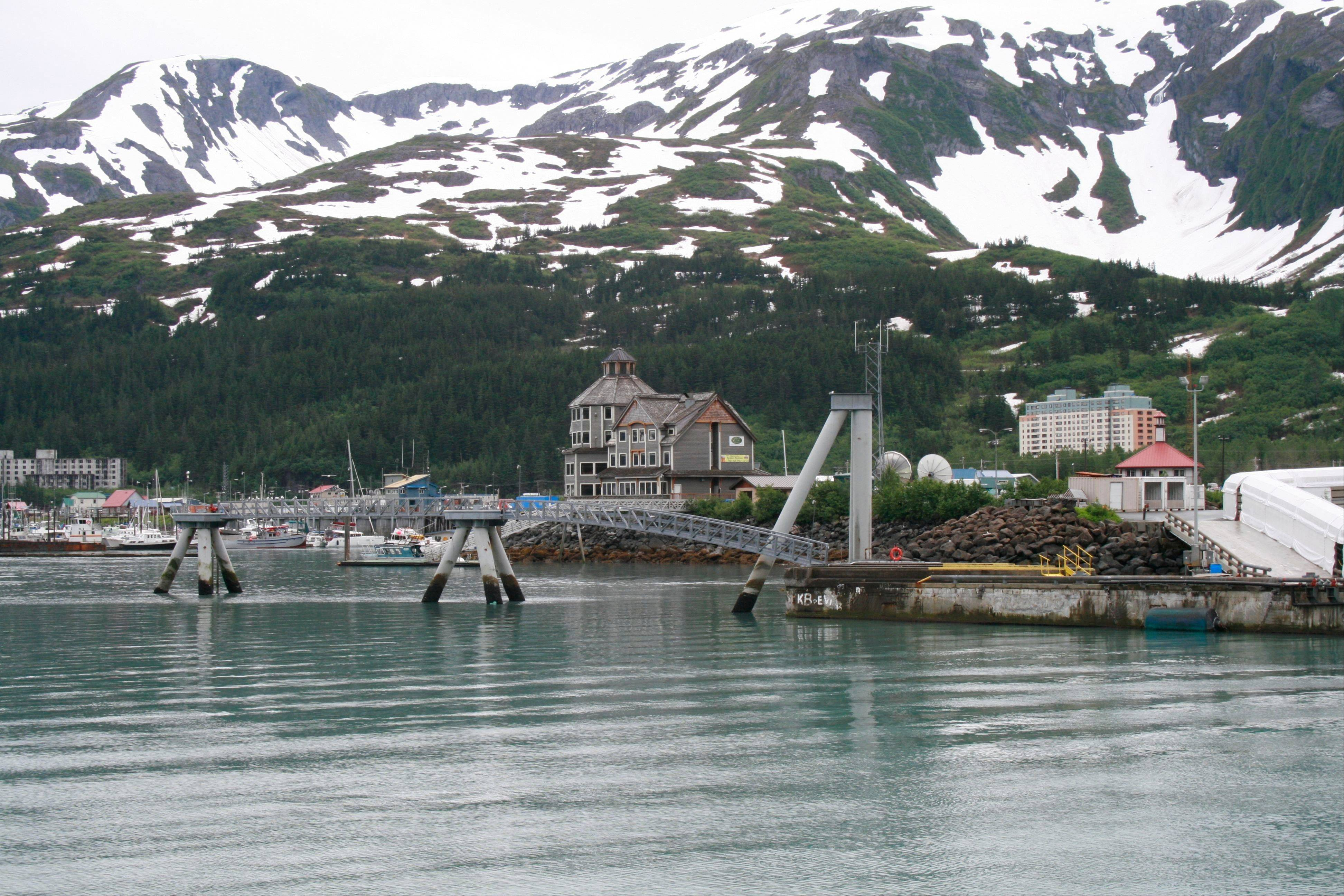 The tiny community of Whittier, Alaska, where most of the 180 year-round residents live in the tall condo in the back, a former Army garrison, is a scenic place to kayak, hike trails or visit a few tourist shops, cafes and restaurants.
