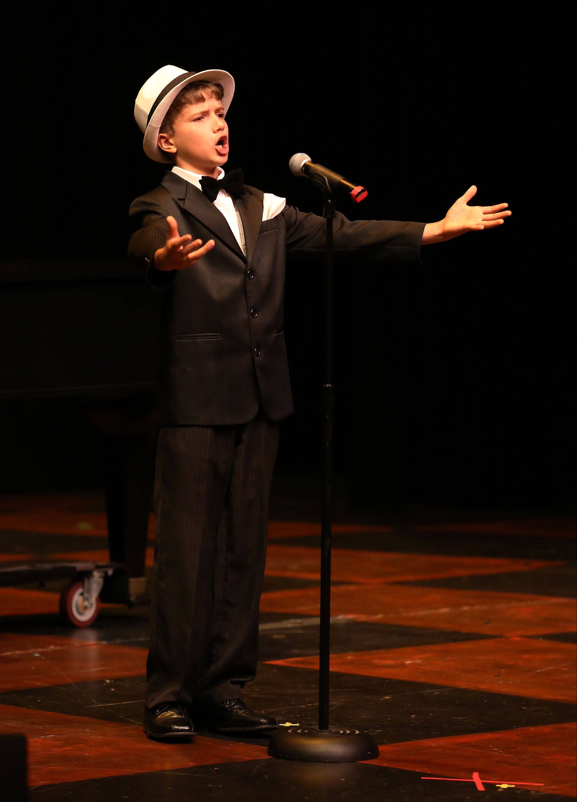 Sheridan Archbold, 11, of Yorkville, performs opera during the first round of finalists for the Suburban Chicago's Got Talent competition Sunday night at the Metropolis Performing Arts Centre in Arlington Heights. The summer-long talent contest is presented by the Daily Herald and sponsored by the Arlington Heights Chamber of Commerce.