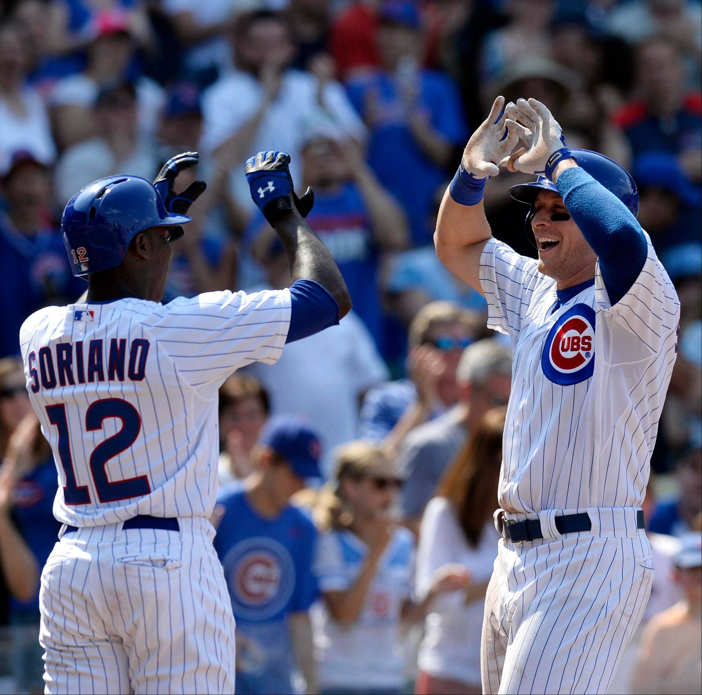 Alfonso Soriano greets Ryan Sweeney at home plate after Sweeney�s 3-run homer in the seventh inning Sunday at Wrigley Field. Sweeney finished with a career-high 6 RBI in the Cubs� 14-6 victory over Houston.