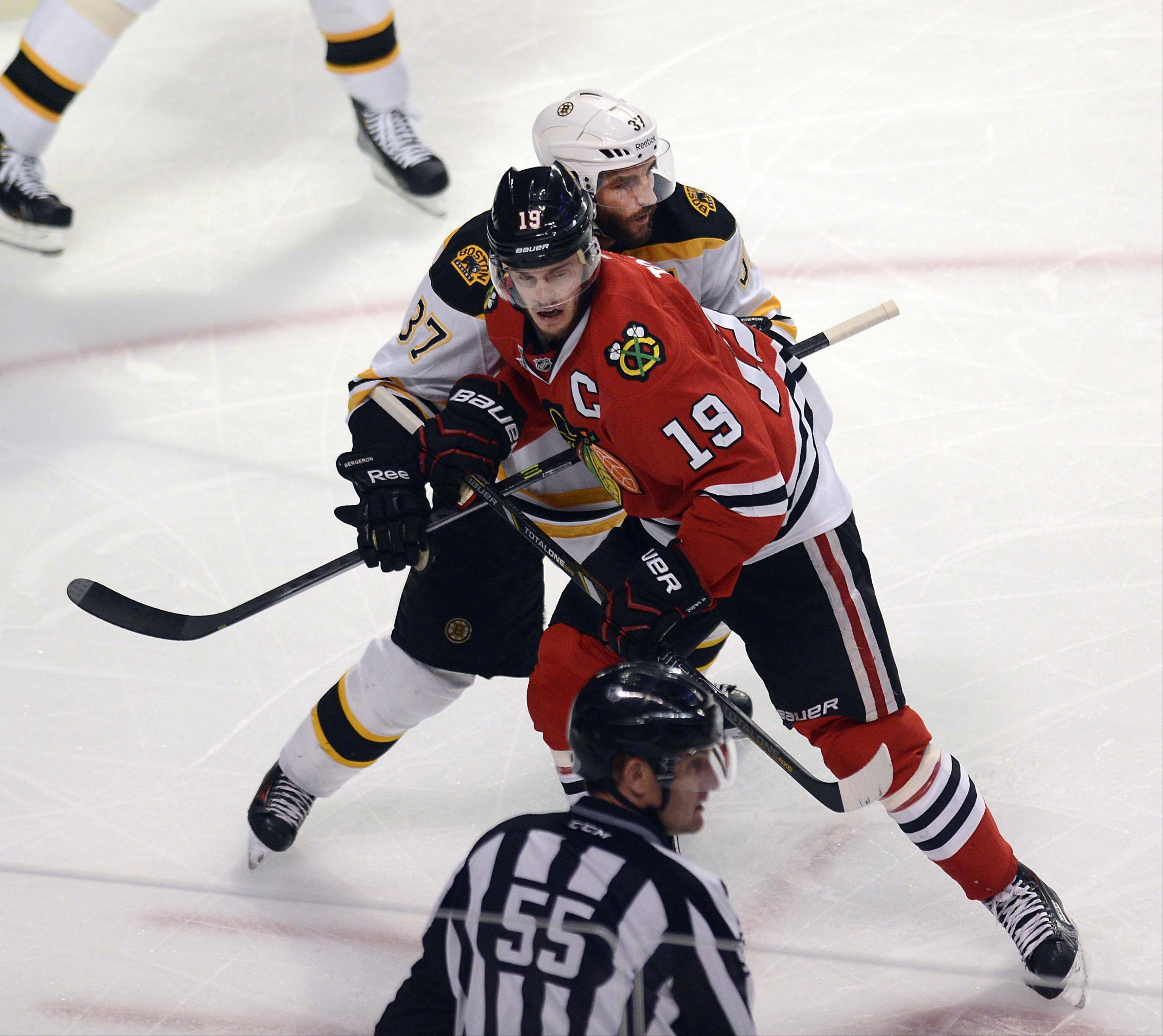 The Bruins' Patrice Bergeron and Blackhawks captain Jonathan Toews are both questionable for tonight's Game 6 of the Stanley Cup Final in Boston because of injuries suffered Saturday in Game 5 at the United Center.