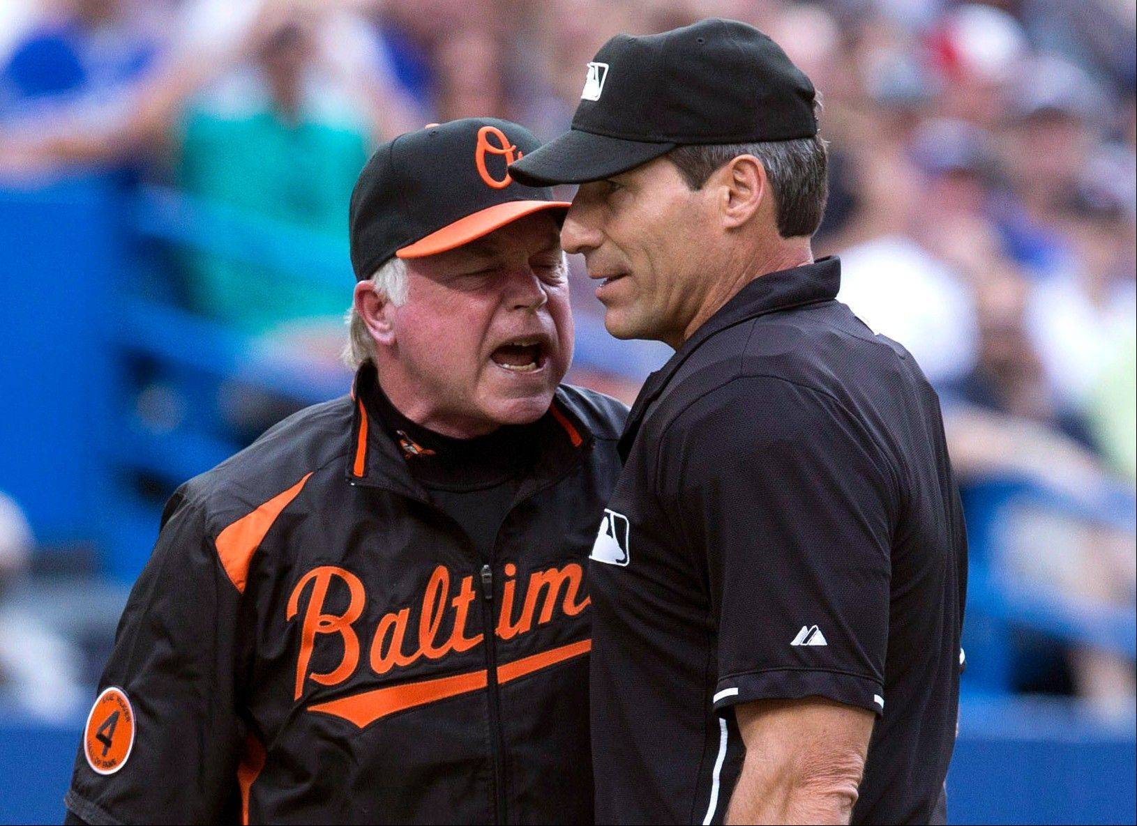 While there is plenty of talking in baseball over calls, as Baltimore Orioles manager Buck Showalter and umpire Angel Hernandez show here, the game's rule book also can trigger some lively discussion.