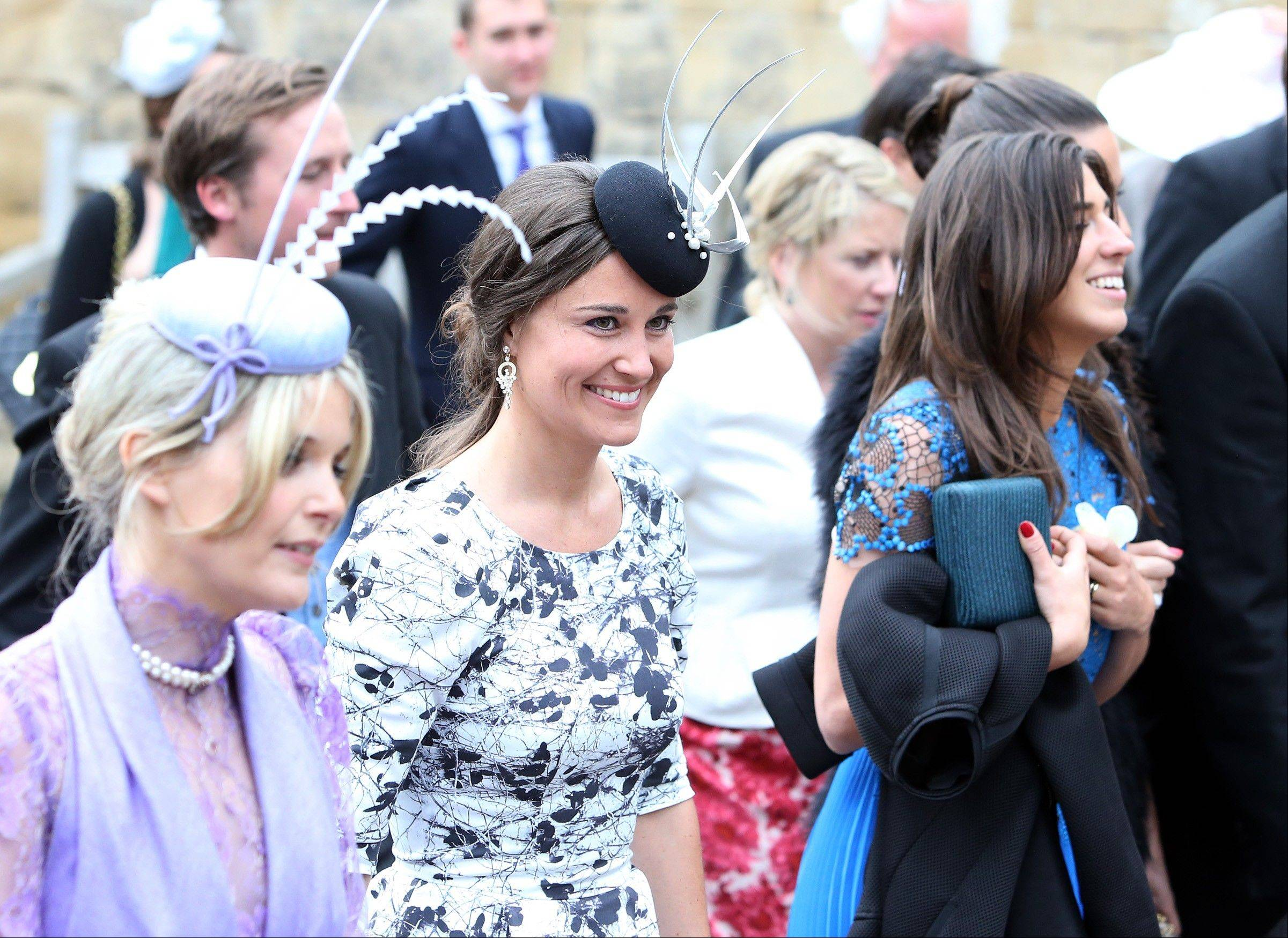 Britain's Pippa Middleton, centre, leaves after attending the wedding of the Duke and Duchess of Northumberland's daughter Lady Melissa Percy to chartered surveyor Thomas van Straubenzee at St Michael's Church in Alnwick, England, Saturday, June 22, 2013.