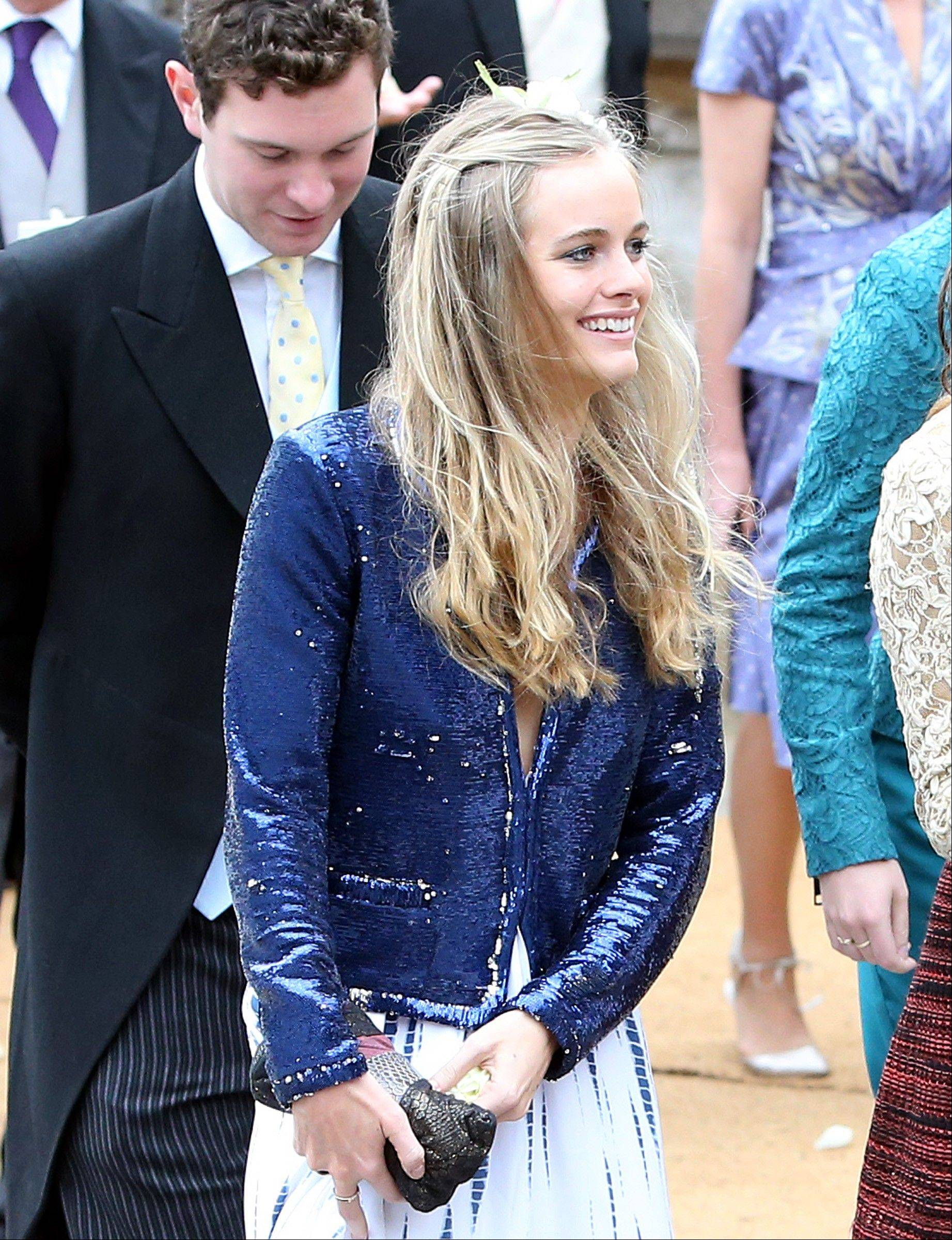 Cressida Bonas, who is the girlfriend of Britain's Prince Harry, leaves after attending the wedding of the Duke and Duchess of Northumberland's daughter Lady Melissa Percy to chartered surveyor Thomas van Straubenzee at St Michael's Church in Alnwick, England, Saturday, June 22, 2013.