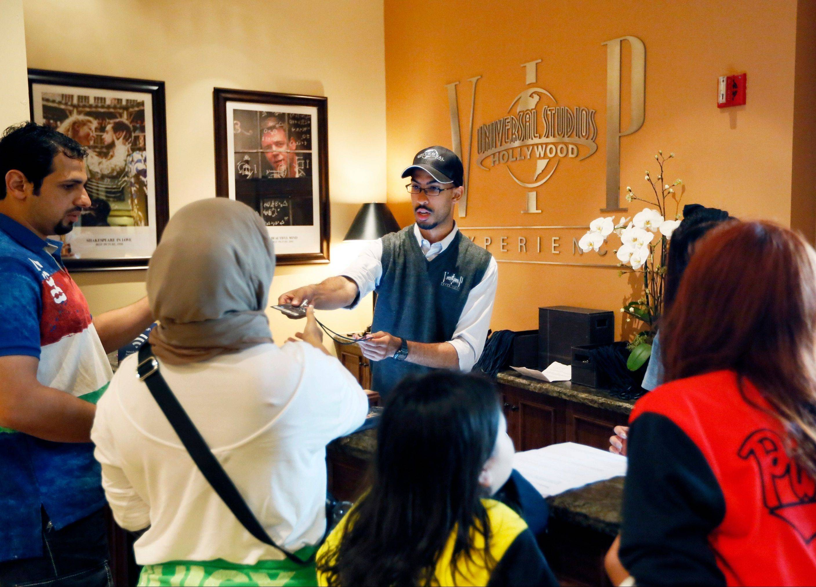 Tourists get instructions at the VIP Experience counter at Universal Studios in Los Angeles.