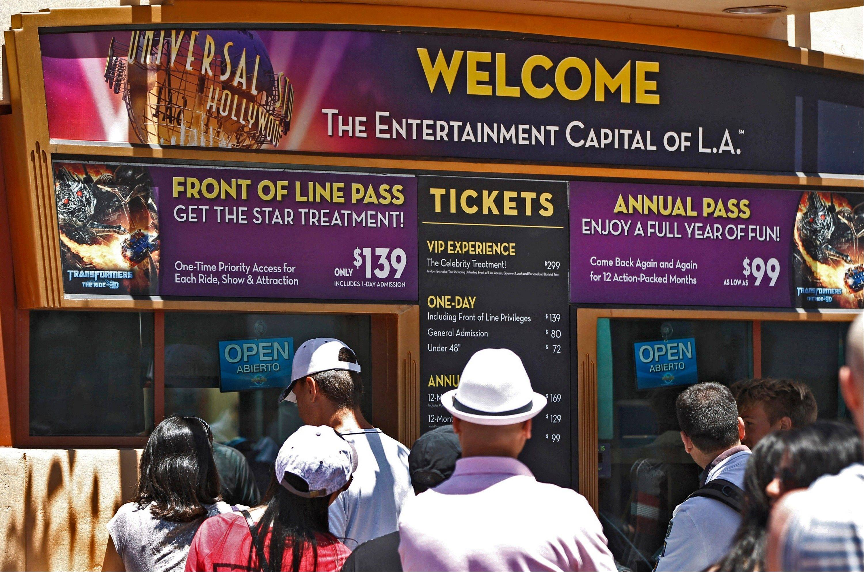 Tourists purchase tickets at Universal Studios Hollywood in Los Angeles.