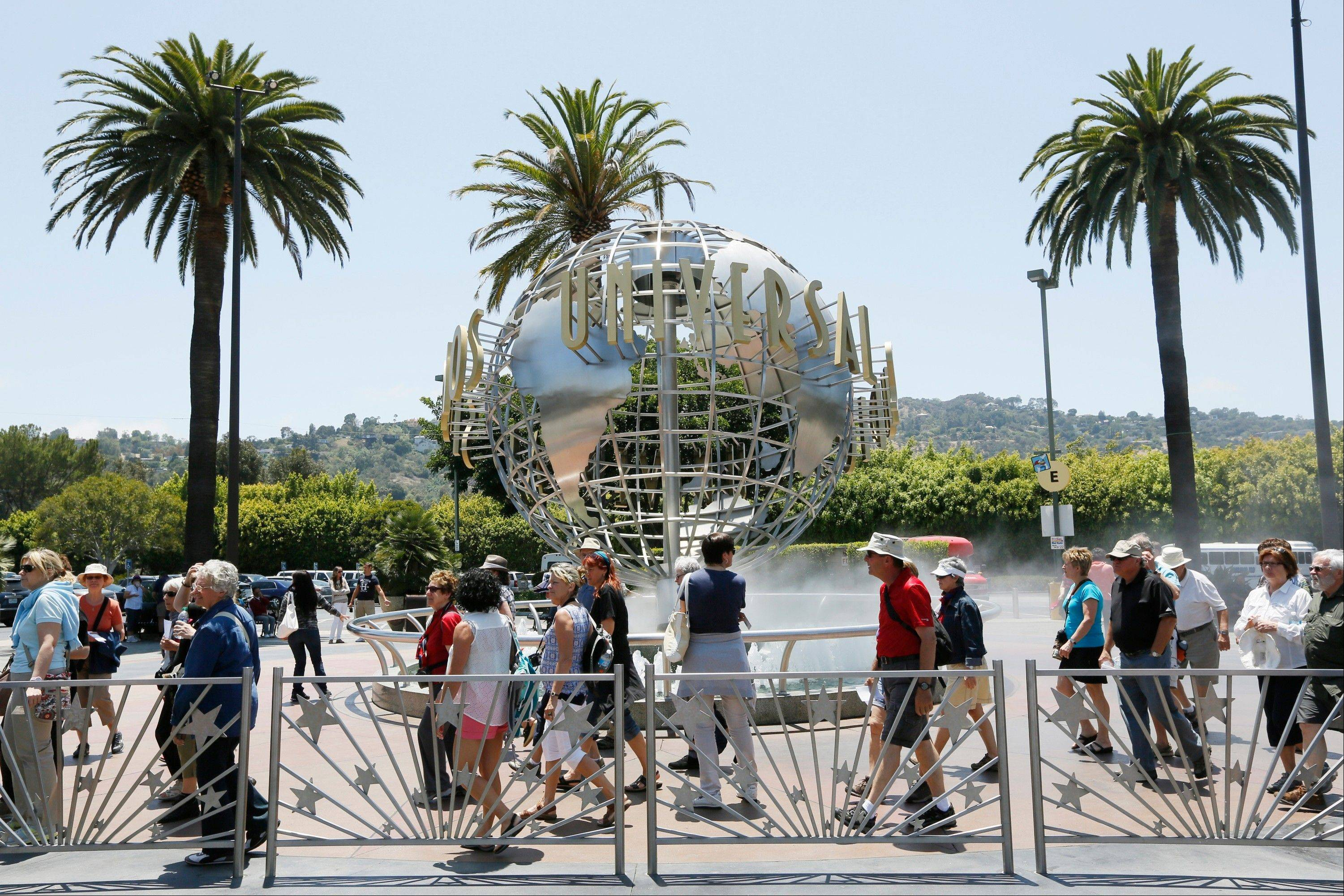 Tourists line up at the normal line at Universal Studios Hollywood in Los Angeles.