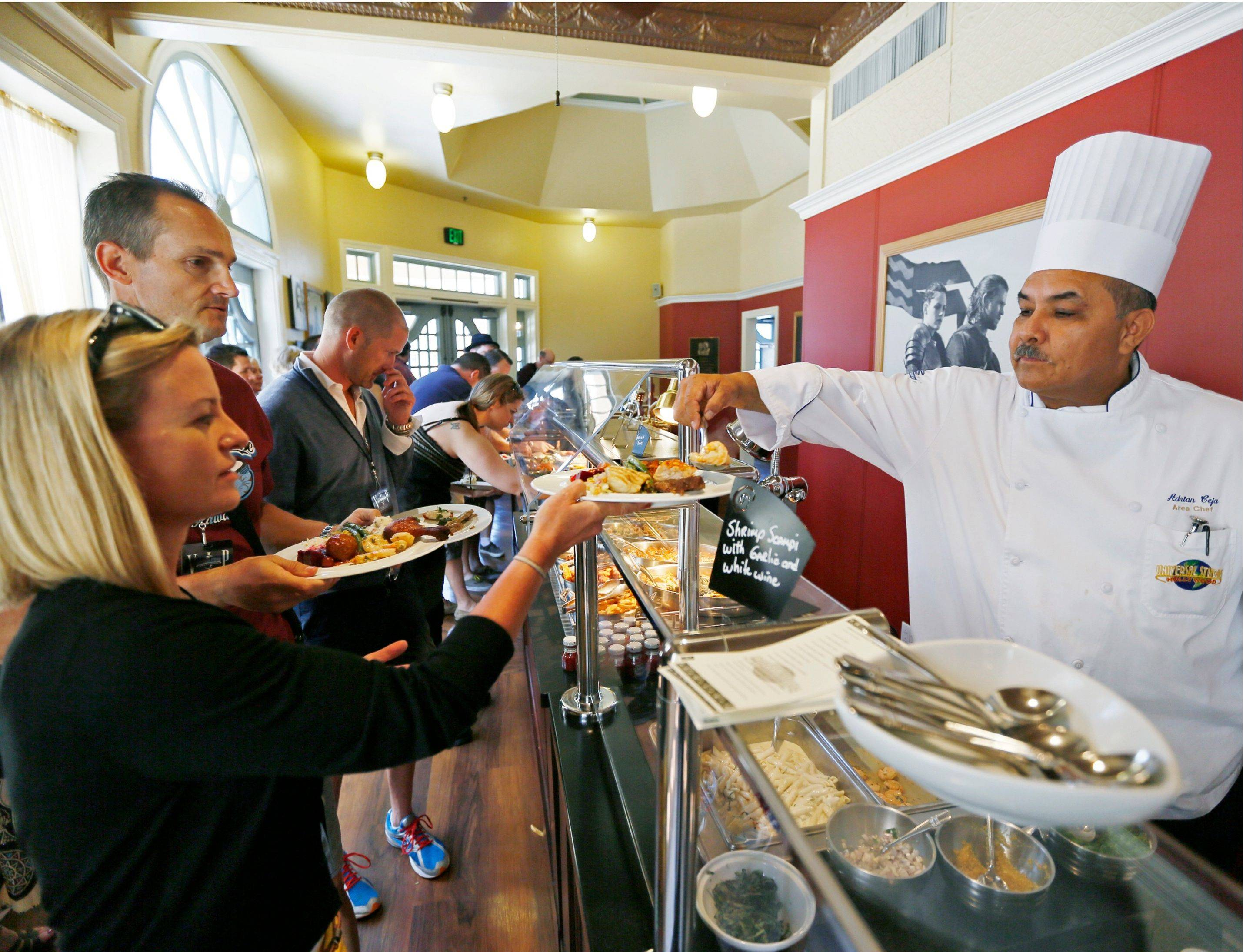 "Tourists receive a gourmet lunch on their Universal Studios Hollywood's ""VIP Experience,"" a $299 per person ticket that includes a private trolley, lunch, a VIP lounge and amenities."
