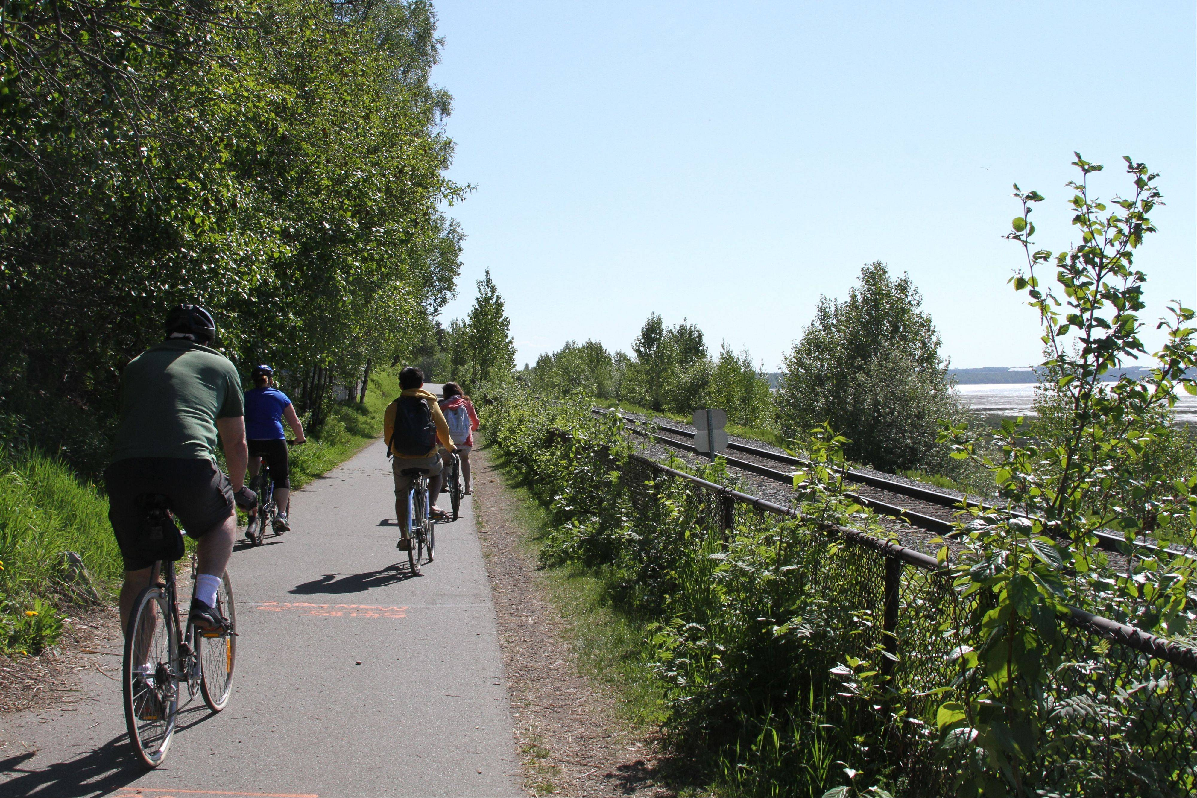 People use the Tony Knowles Coastal Trail in downtown Anchorage, Alaska, which offers more than 135 miles of multi-use trails.