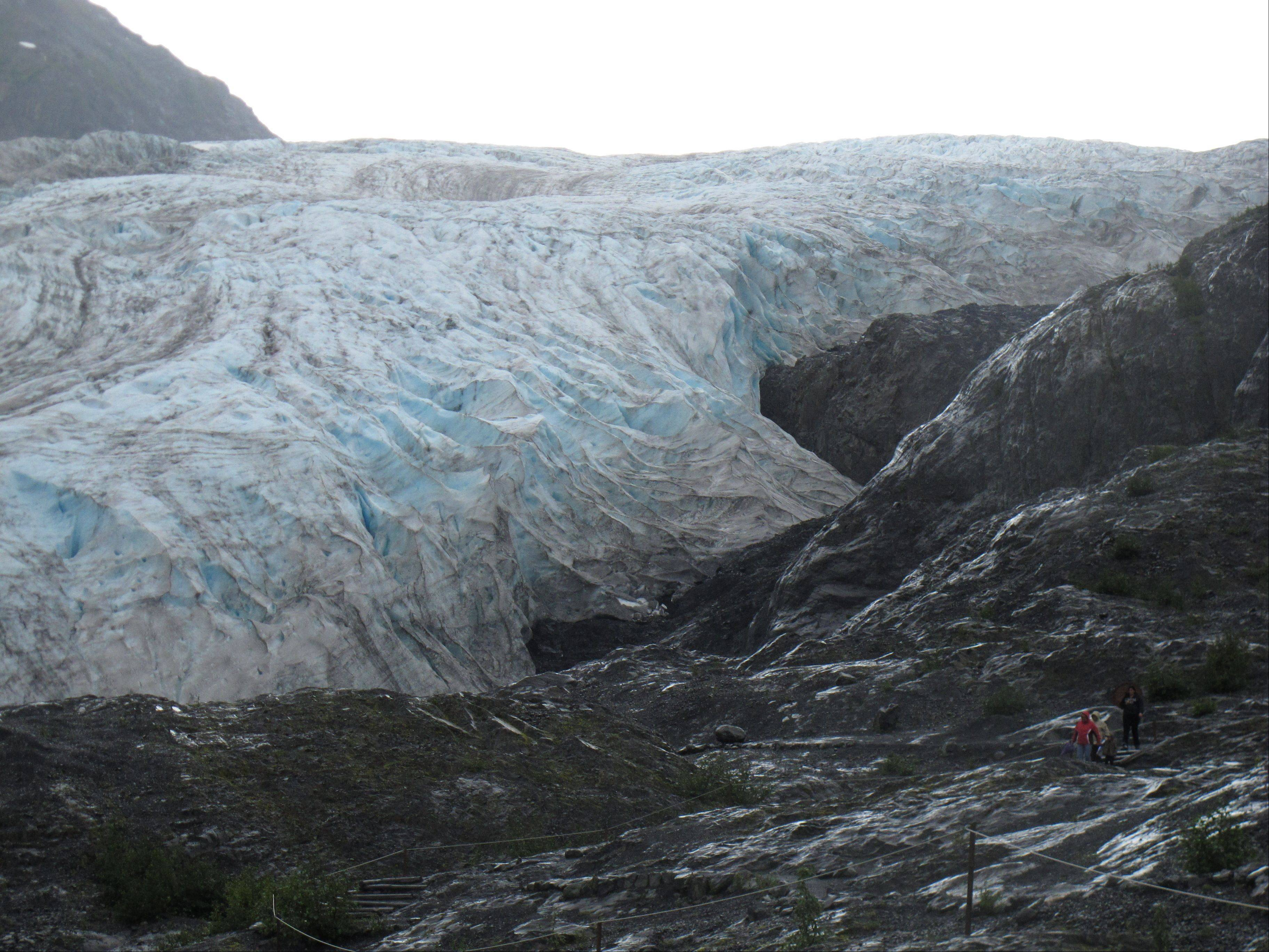 Tourists walk to Exit Glacier in Kenai Fjords National Park just outside Seward, Alaska.