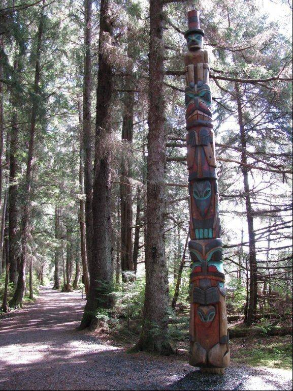Visitors can view totems and more along the history walk at the Sitka National Historical Park in Alaska.