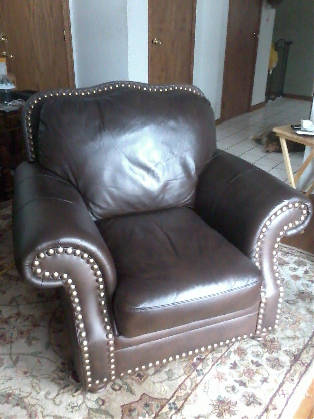 The same leather chair is shown after it has been restored by Fibrenew.