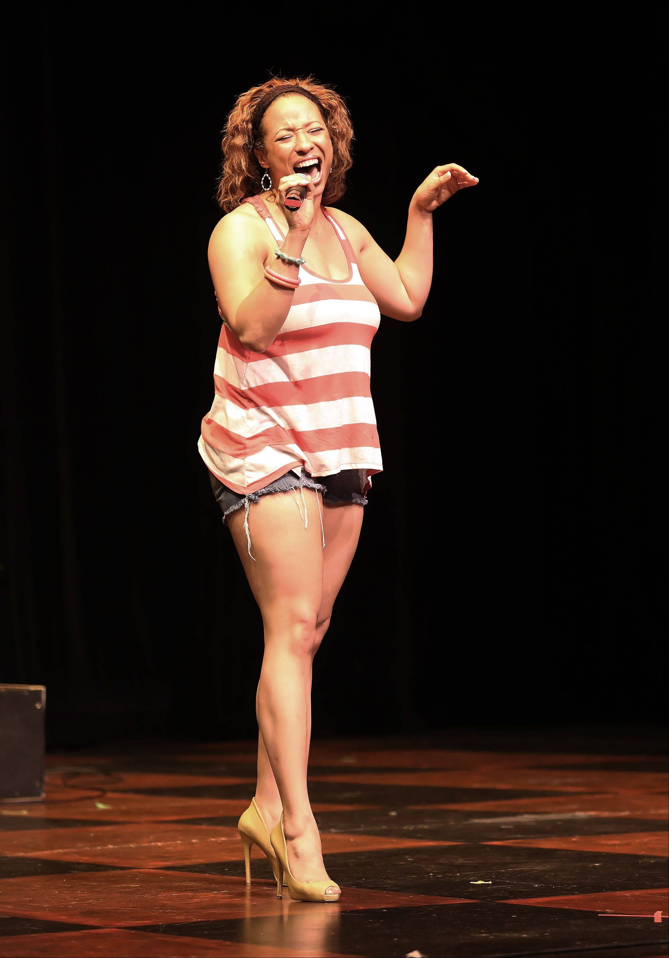 Tiffany Turner sings during the first round of finalists for the Suburban Chicago's Got Talent competition Sunday night at the Metropolis Performing Arts Centre in Arlington Heights. The summer-long talent contest is presented by the Daily Herald and sponsored by the Arlington Heights Chamber of Commerce.