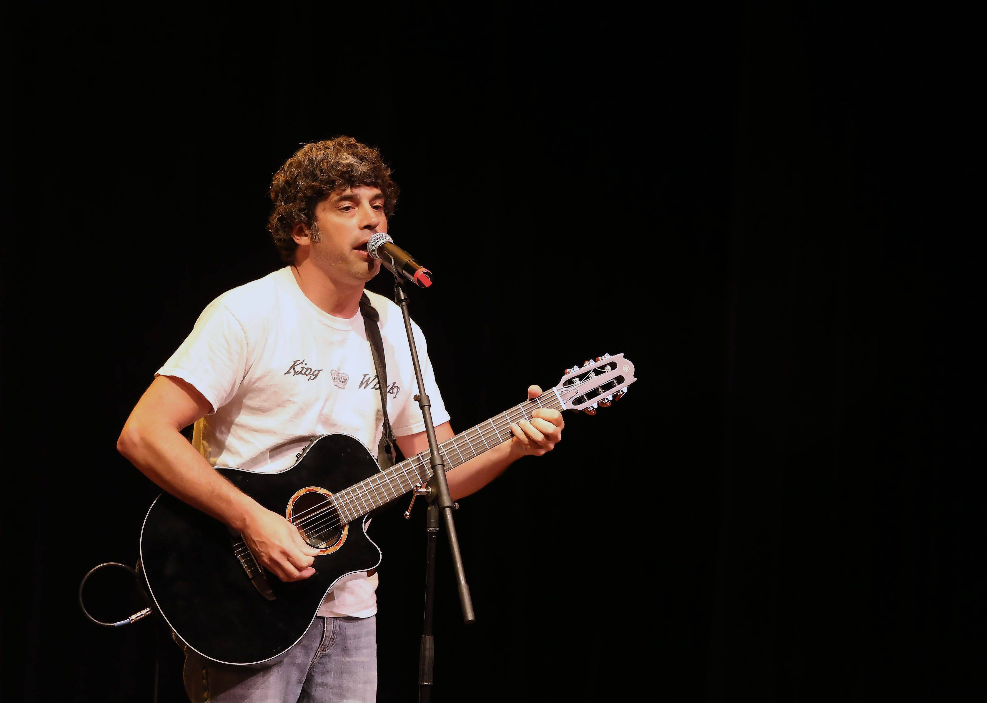 "Joe Calderone of the band King Whisky sings an original song called ""Cotton Candy"" during the first round of finalists for the Suburban Chicago's Got Talent competition Sunday night at the Metropolis Performing Arts Centre in Arlington Heights. The summer-long talent contest is presented by the Daily Herald and sponsored by the Arlington Heights Chamber of Commerce."