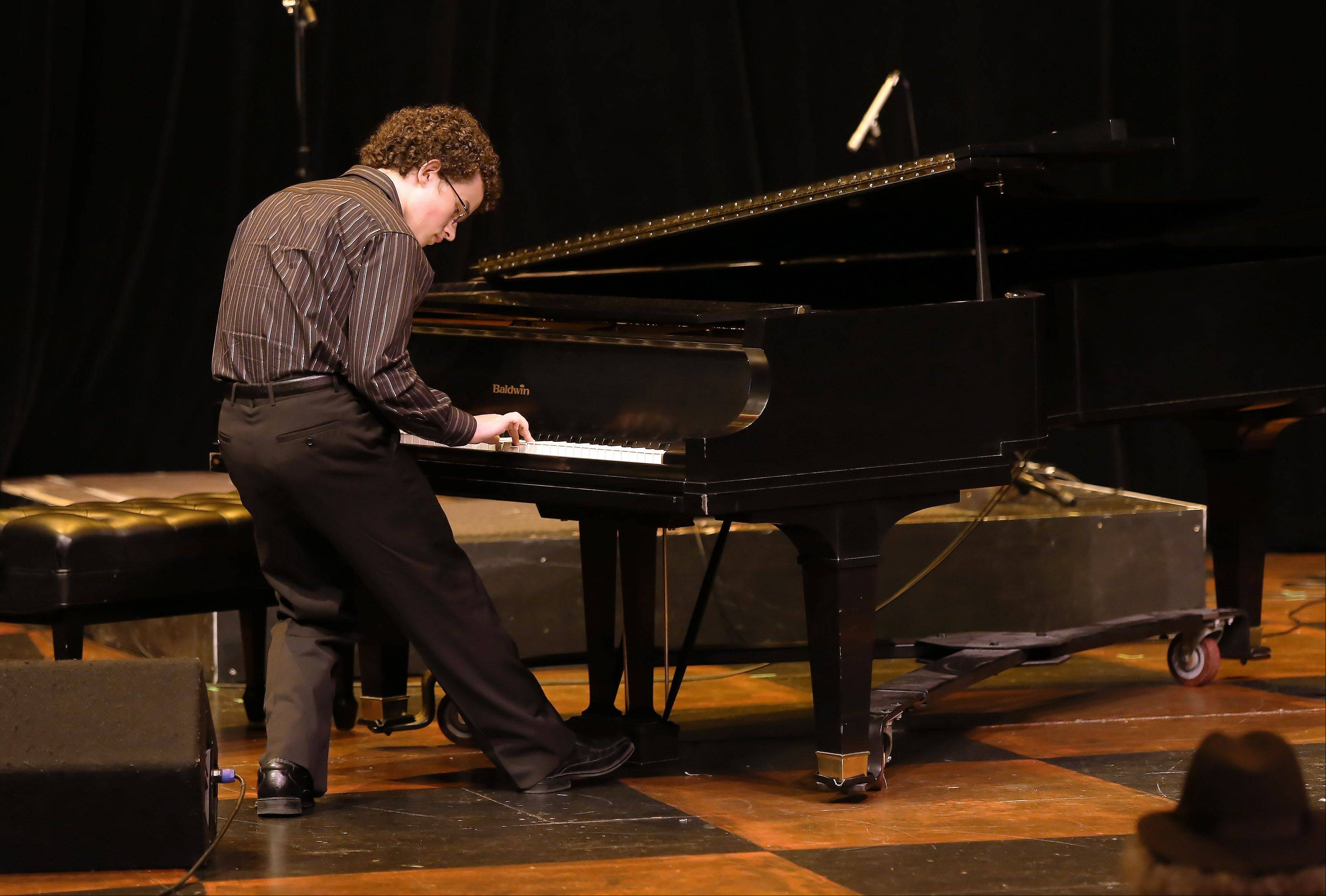 "Joey White of Huntley plays the song ""Freebird"" on the piano during the first round of finalists for the Suburban Chicago's Got Talent competition Sunday night at the Metropolis Performing Arts Centre in Arlington Heights. The summer-long talent contest is presented by the Daily Herald and sponsored by the Arlington Heights Chamber of Commerce."