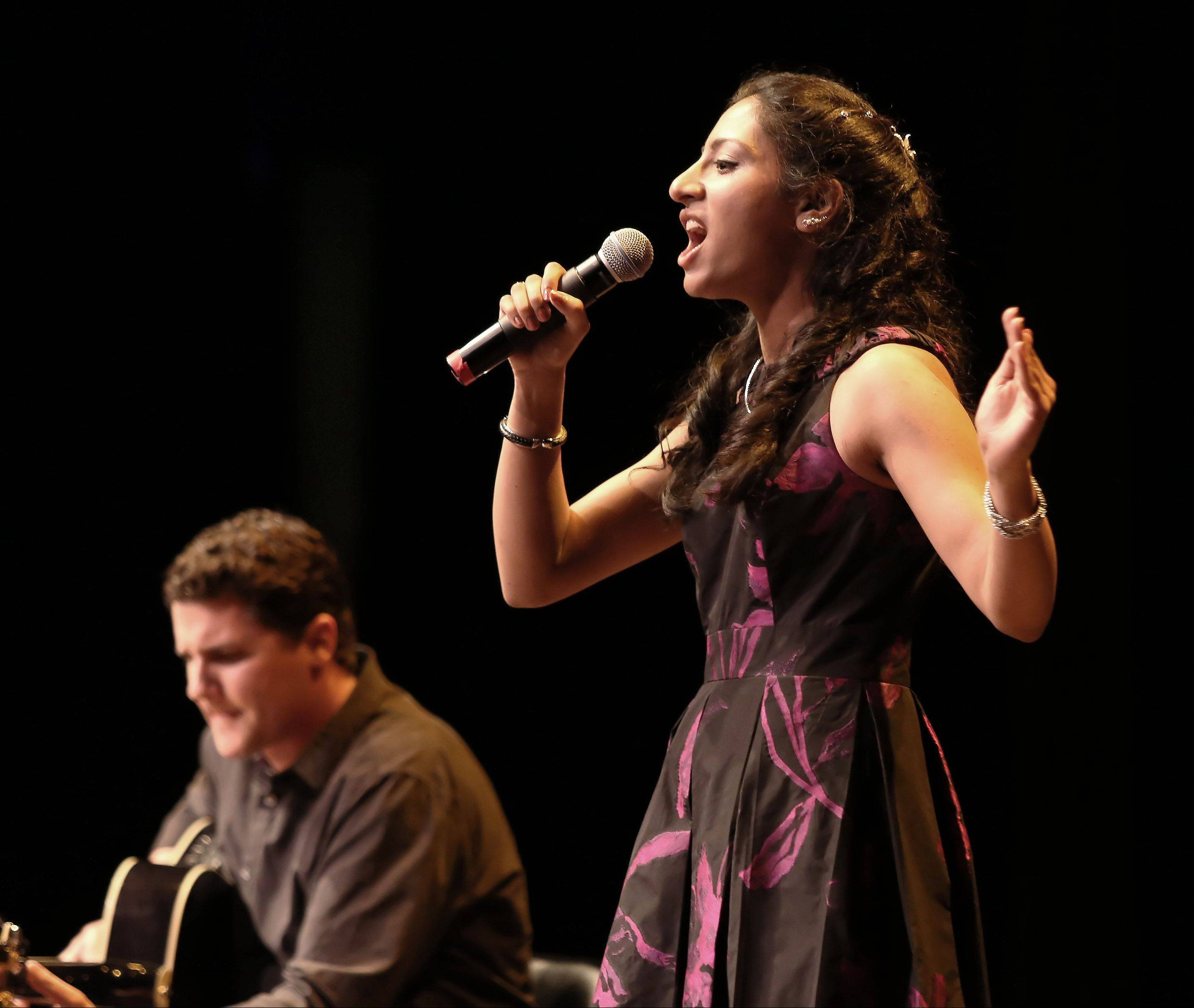 Divya Pillai of Oak Brook sings during the first round of finalists for the Suburban Chicago's Got Talent competition Sunday night at the Metropolis Performing Arts Centre in Arlington Heights. The summer-long talent contest is presented by the Daily Herald and sponsored by the Arlington Heights Chamber of Commerce.