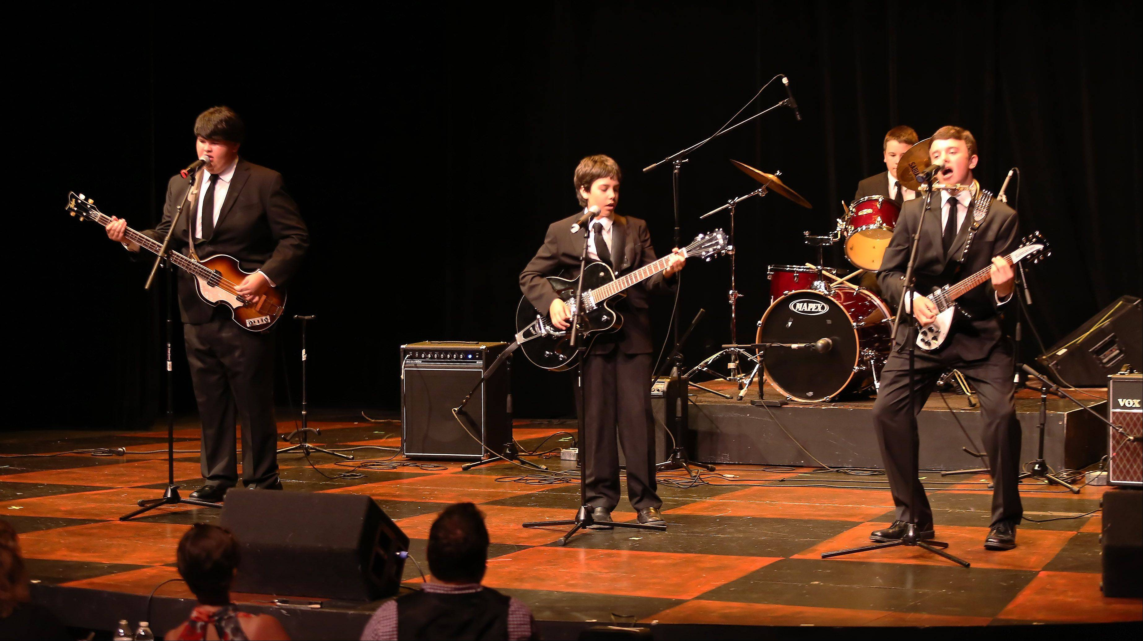 "Beatles tribute band Merseyside performs the song ""Please Please Me"" during the first round of finalists for the Suburban Chicago's Got Talent competition Sunday night at the Metropolis Performing Arts Centre in Arlington Heights. The summer-long talent contest is presented by the Daily Herald and sponsored by the Arlington Heights Chamber of Commerce."