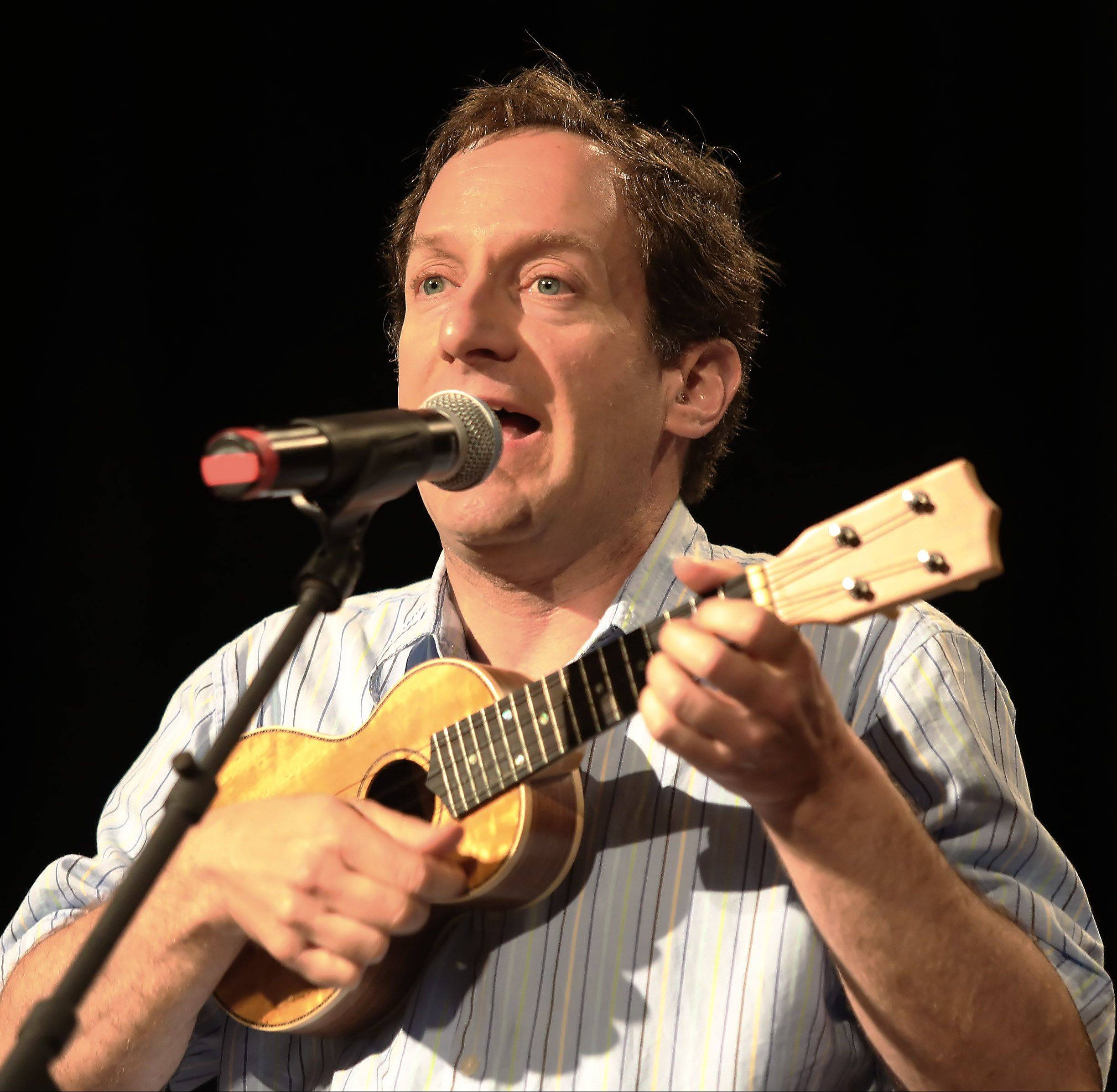"Mark Lyons of Palatine plays the ukulele as he sings an original tune called ""Like a Mushroom"" during the Suburban Chicago's Got Talent competition Sunday night at the Metropolis Performing Arts Centre in Arlington Heights. The summerlong talent contest is presented by the Daily Herald and sponsored by the Arlington Heights Chamber of Commerce."