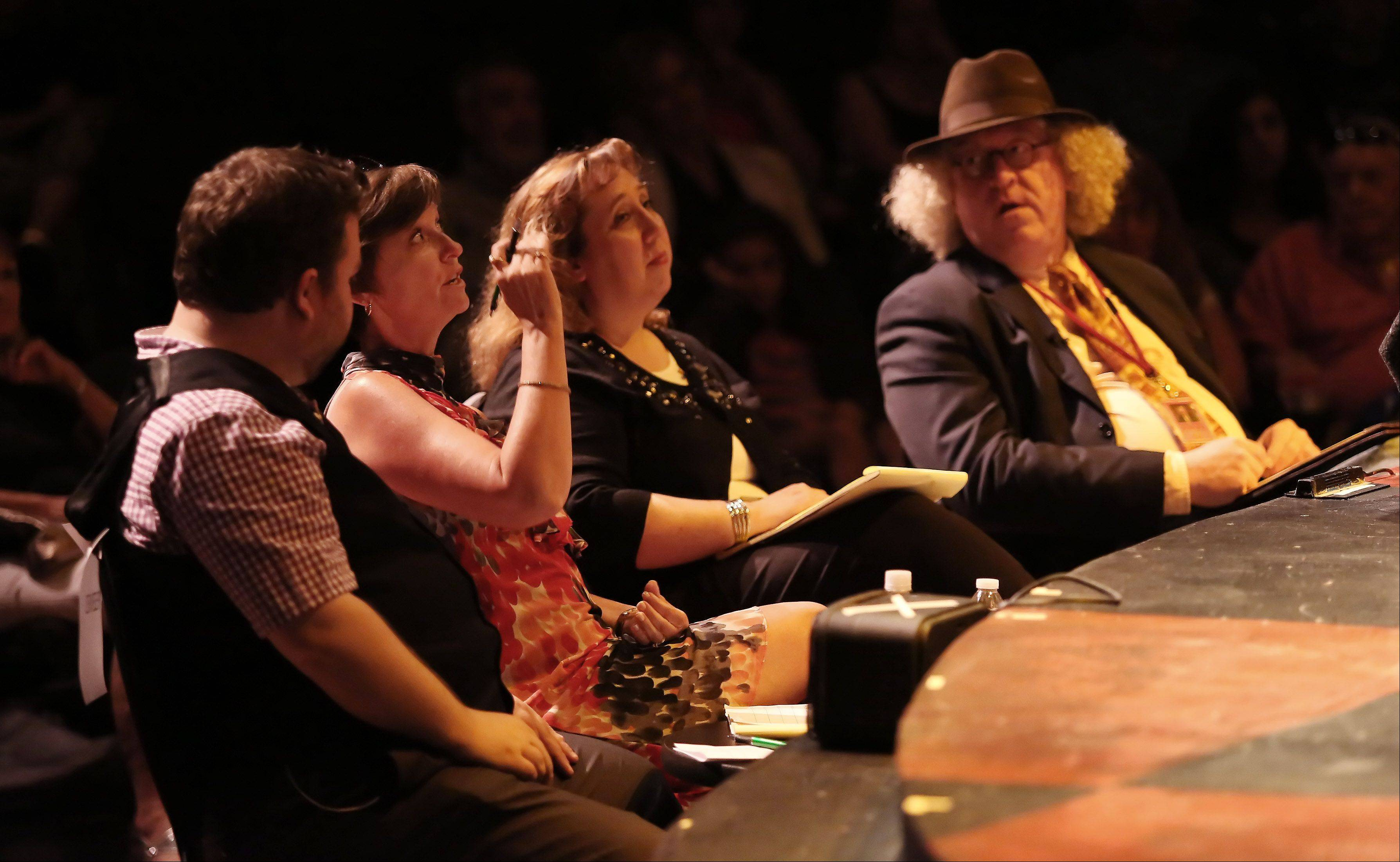 Talent judges Micky York, left, Connie Canaday Howard, Barbara Vitello, and Charlie Beck reflect on an act during the first round of the finalists for Suburban Chicago's Got Talent competition Sunday night at the Metropolis Performing Arts Centre in Arlington Heights. The summer-long talent contest is presented by the Daily Herald and sponsored by the Arlington Heights Chamber of Commerce.
