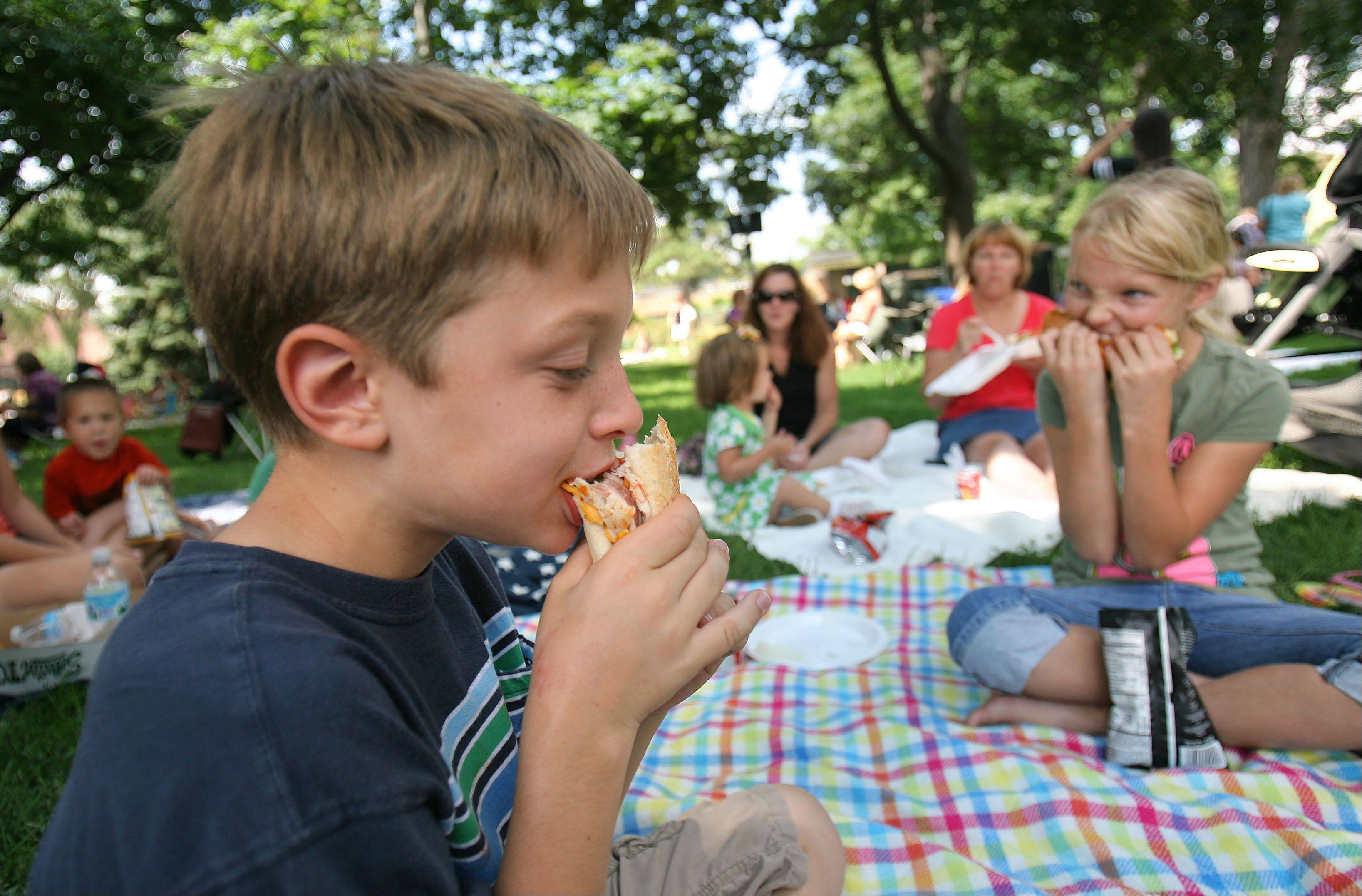 Joey Perrone and Sarah Krahnke of Libertyville munch down some sandwiches at the Out to Lunch event in Libertyville's Cook Park.