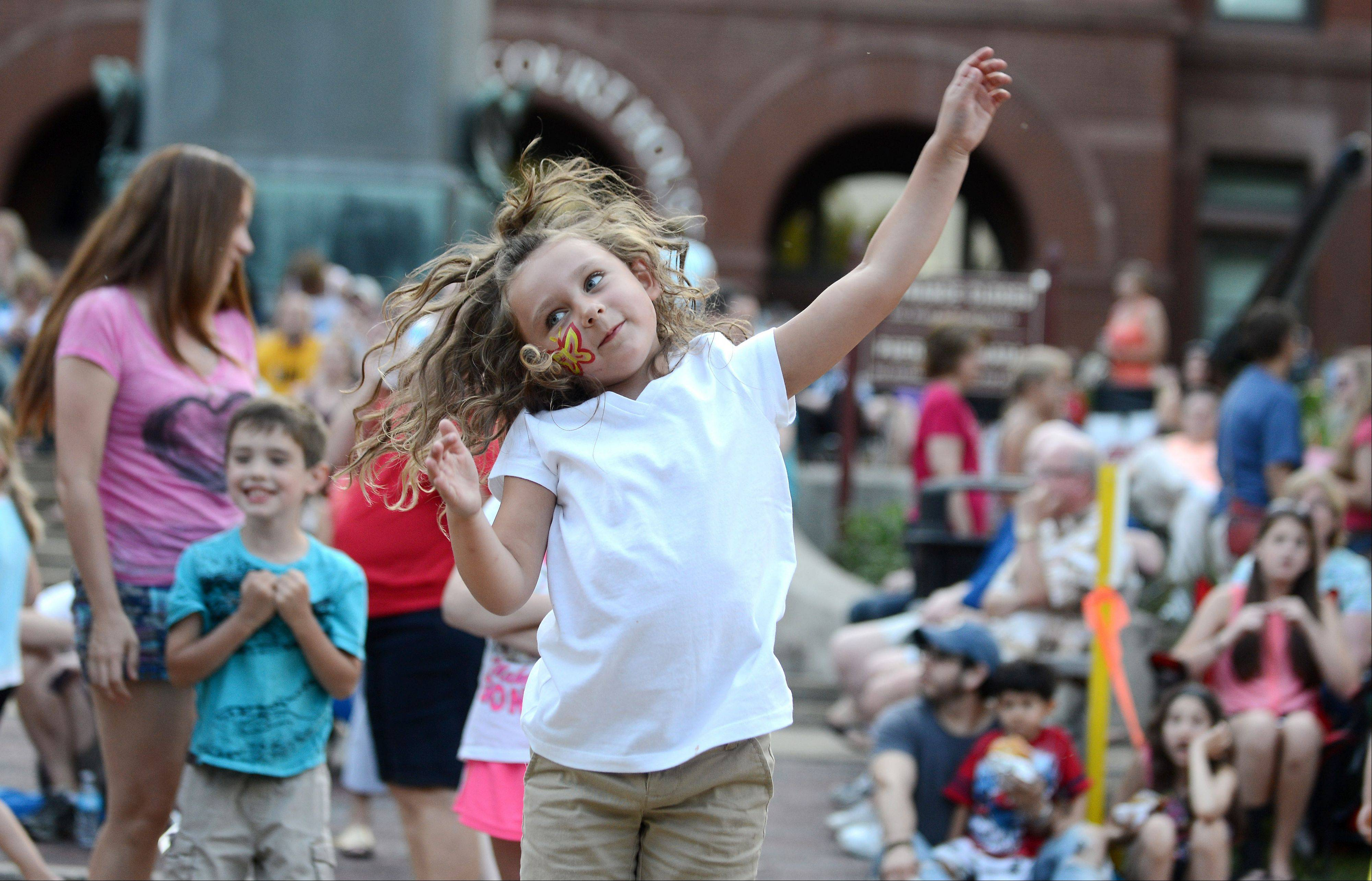 Avarey Fink, 5, of Geneva literally dances in the street as Libido Funk Circus plays during Swedish Days in Geneva Thursday evening.