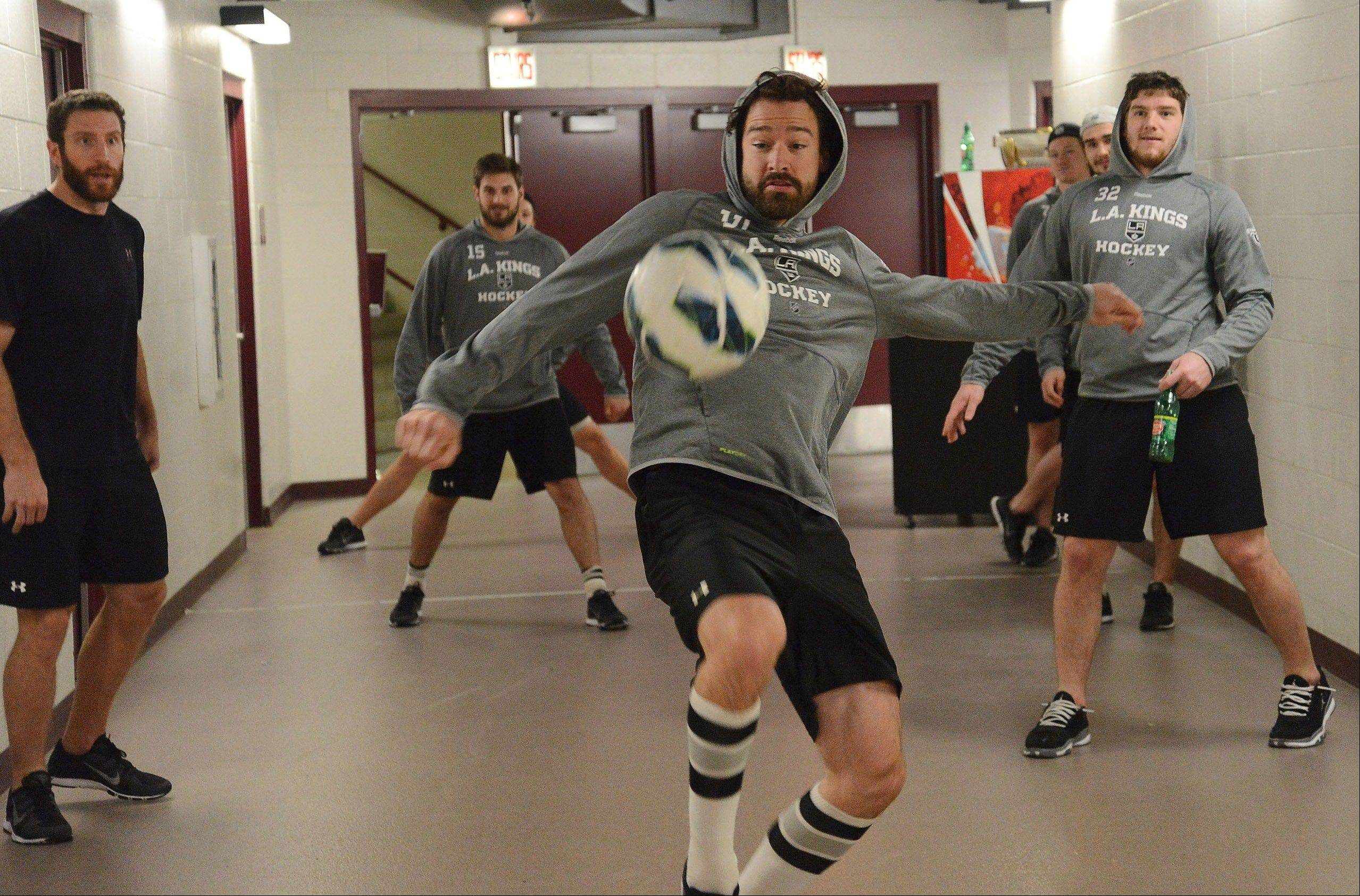 Los Angeles Kings right winger Justin Williams tries to keep the ball in play during a pre-game soccer match in the basement of the United Center, before Game 1 of the Western Conference Finals between the Chicago Blackhawks and the Los Angeles Kings. This has become a tradition for hockey players to loosen up about an hour before puck drop with an impromptu game of soccer or a game of keep away. I used this photo in the weekly Perspective column.