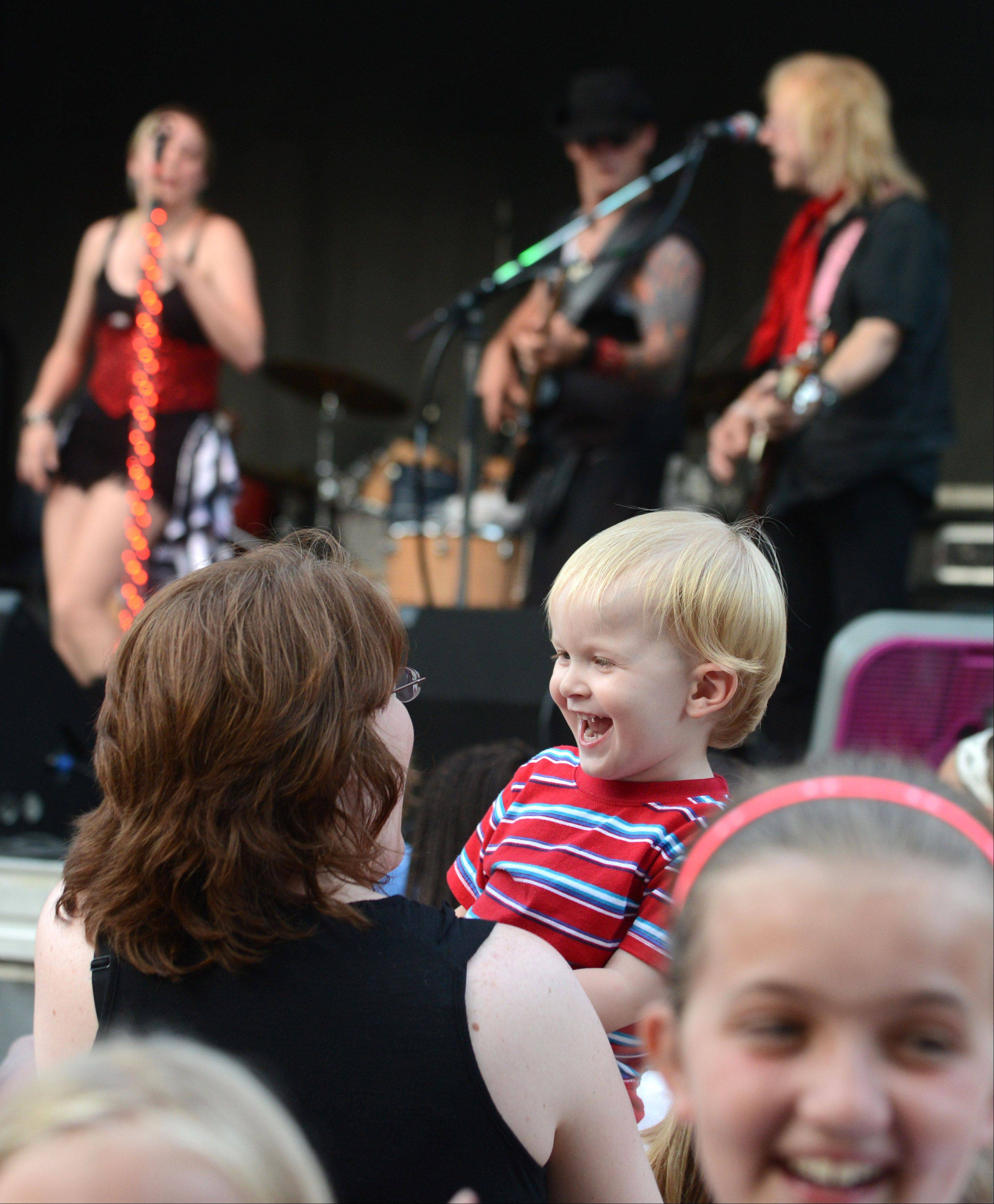 Riley Doshc, 2, and mom Jennifer of North Aurora, enjoy the jams by Libido Funk Circus during Swedish Days in Geneva Thursday evening.