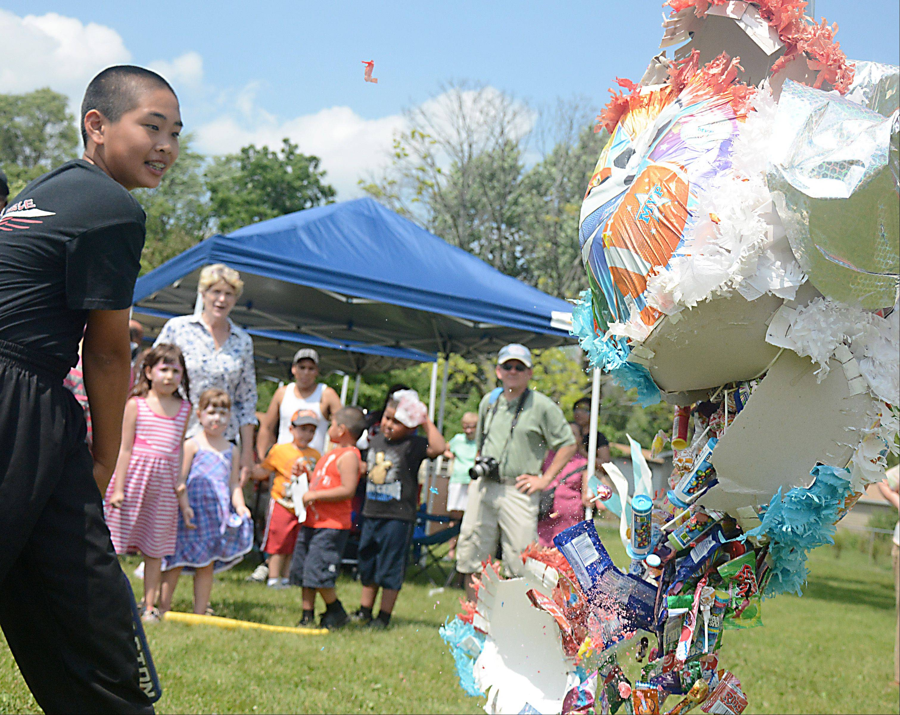 Brent Li, of Hoffman Estates, breaks open a pi�ata at the Wheeling Community Cultural Fest held at Northside Park in Wheeling Sunday.