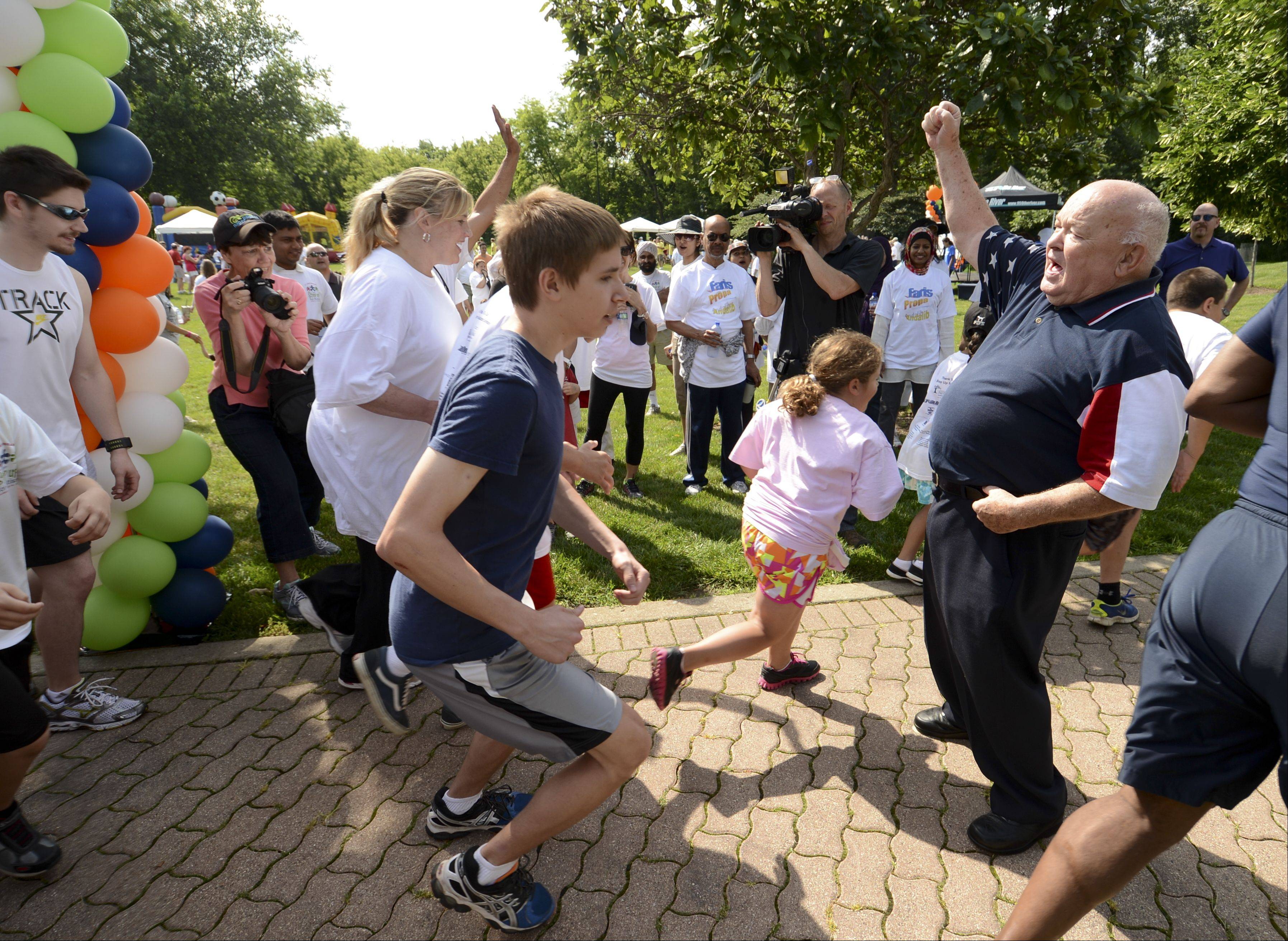 Mayor George Pradel kicks off The Step Up for Autism walk/run in Naperville Sunday. The event raised money for Little Friends Inc., the Naperville agency is know for its for its Autism center as well as its school and training programs for individual with developmental disabilities.