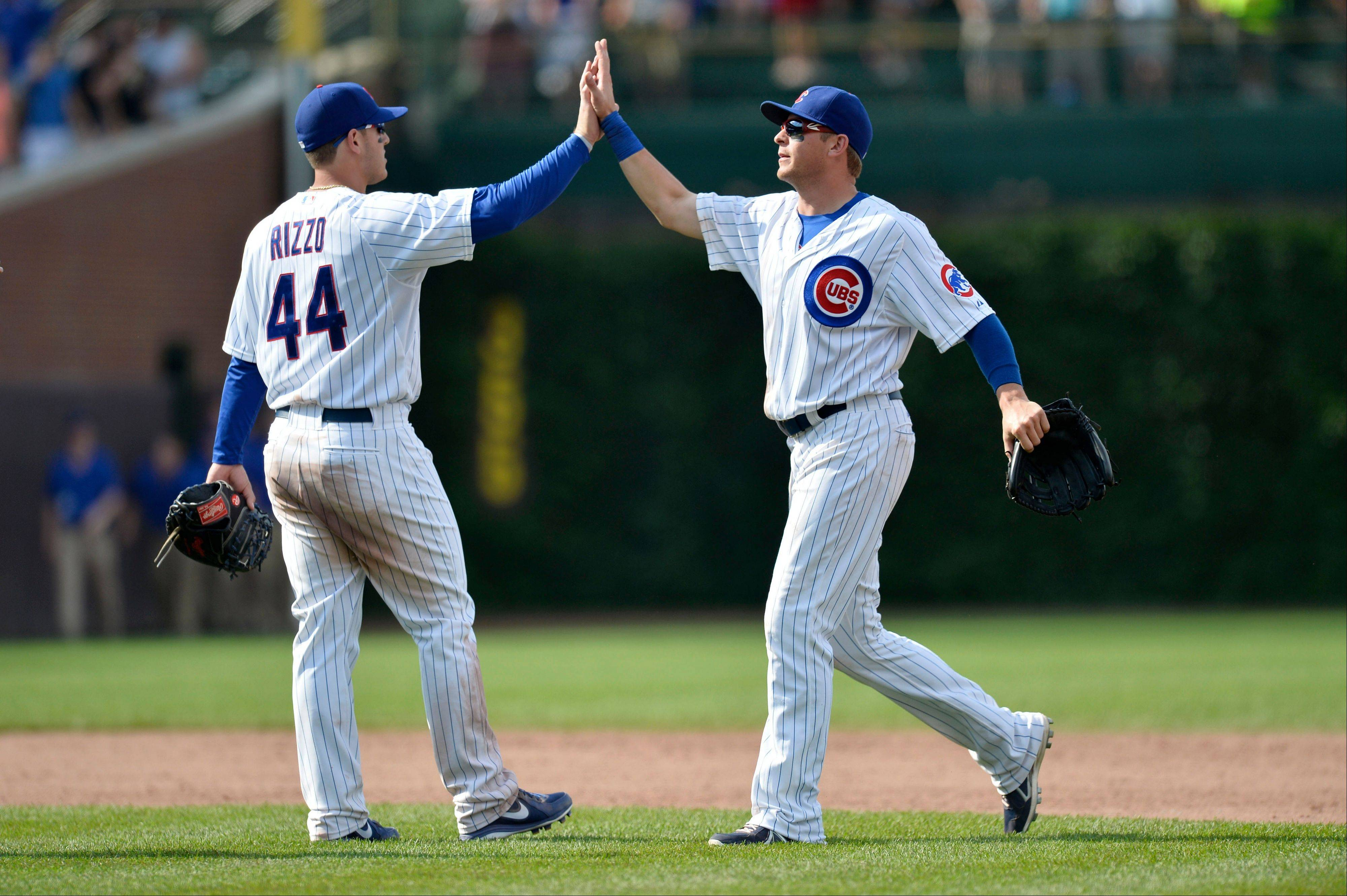 Cubs first baseman Anthony Rizzo, left, and center fielder Ryan Sweeney celebrate a 14-6 win over the Houston Astros in an interleague baseball game on Sunday, June 23, 2013, in Chicago.