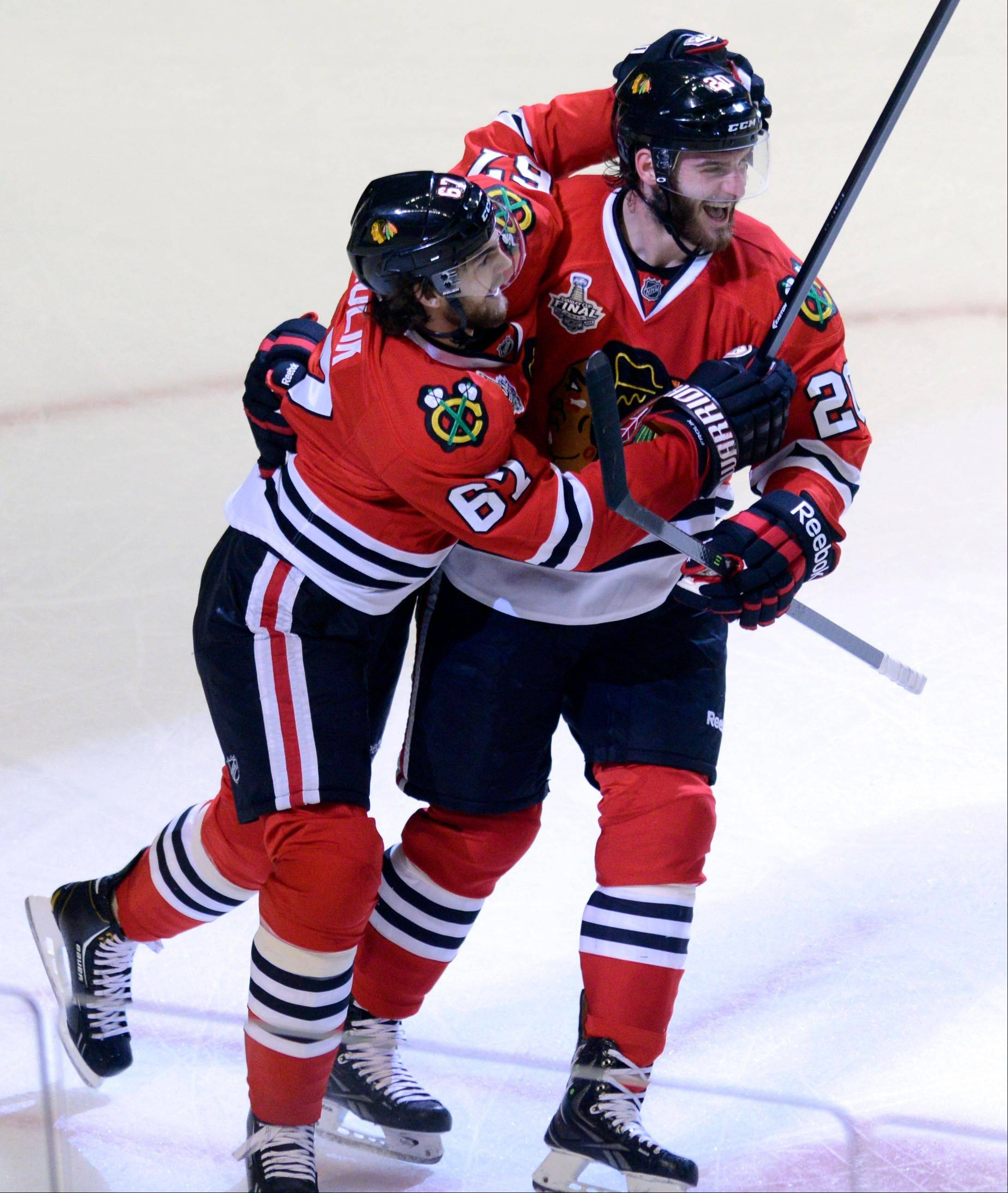 Blackhawks center Michael Frolik and left wing Brandon Saad, here celebrating a goal in Game 1 of the Stanley Cup Final, have enjoyed great success as part of GM Stan Bowman's roster this season.