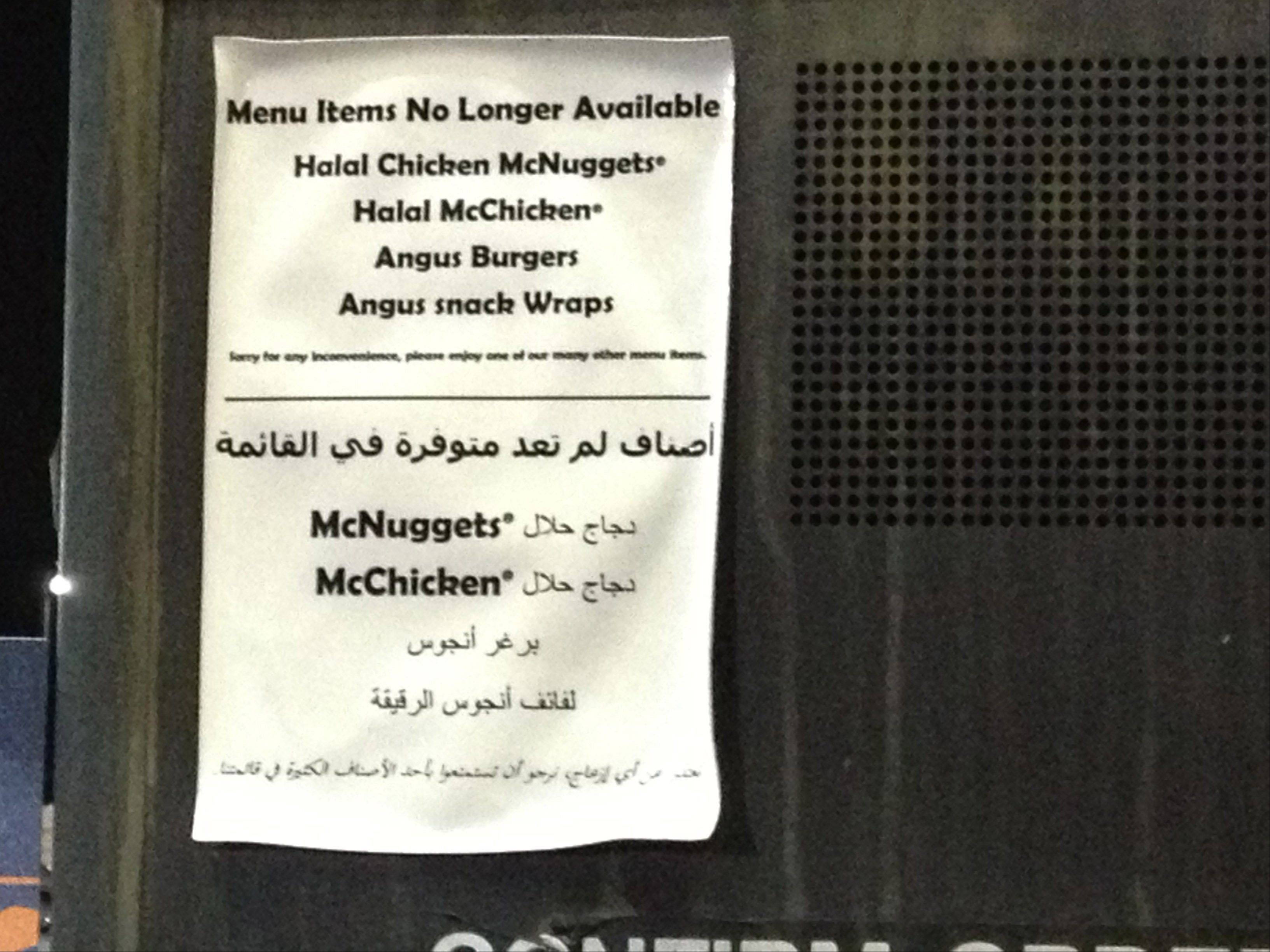 Bilingual signs in English and Arabic at a McDonald�s restaurant in Dearborn, Mich., announce they no longer sell halal products. The only two McDonald�s restaurants in the nation serving food prepared according to Islamic law have stopped doing so after a $700,000 legal settlement.