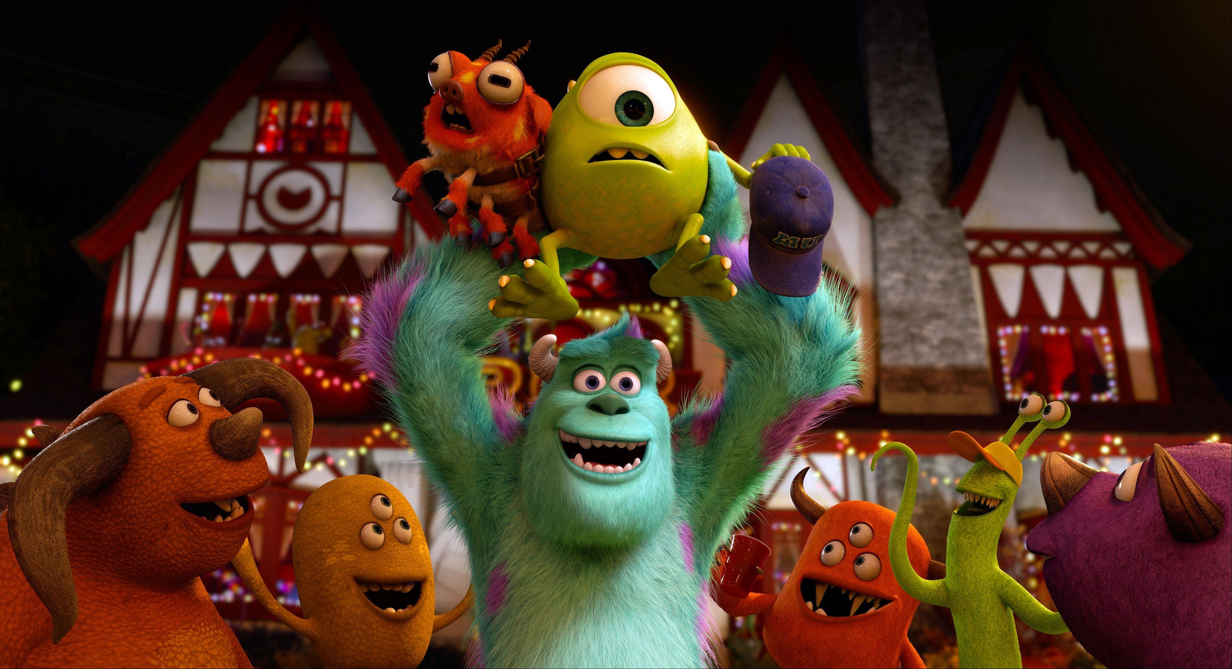 In Pixar�s �Monsters University,� Sully (John Goodman) triumphantly hoists one-eyed Mike (Billy Crystal) during the Scare Games contest.