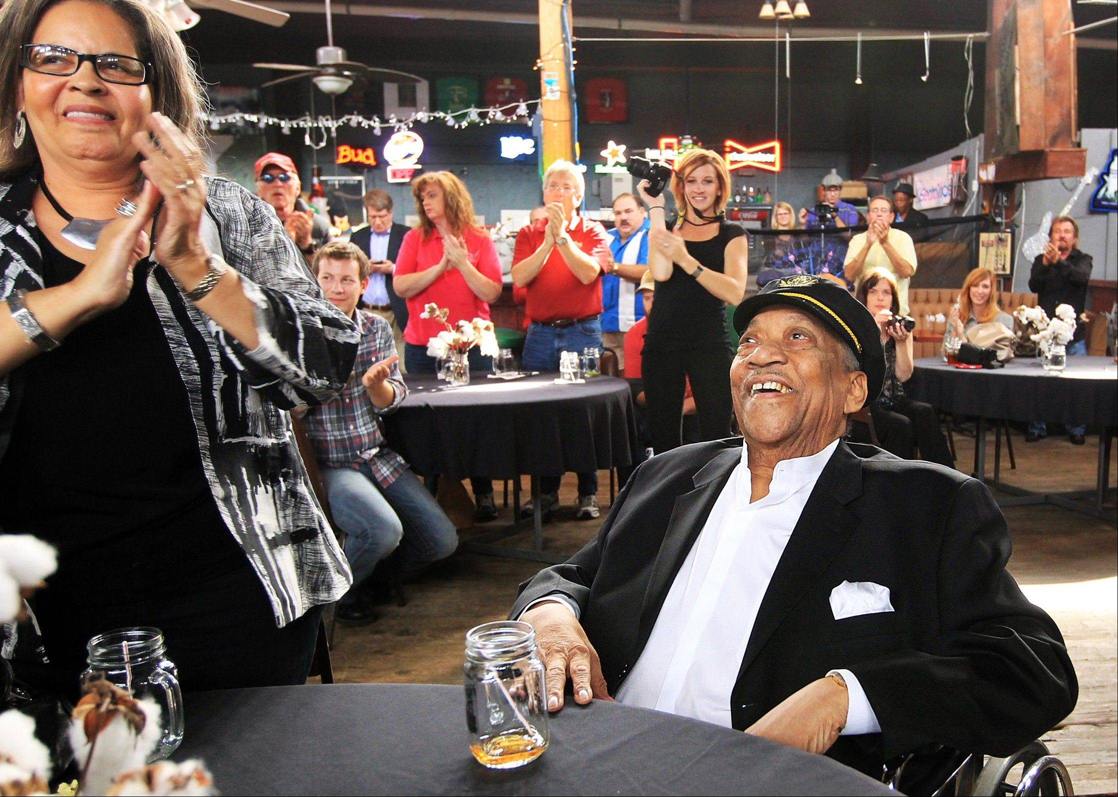 Bobby �Blue� Bland, center, is honored with a standing ovation as he is named as an inductee to the Memphis Music Hall of Fame during a ceremony at The Warehouse in Memphis, Tenn., in 2012, Bland�s son Rodd said his father died Sunday at his Memphis home. He was 83.