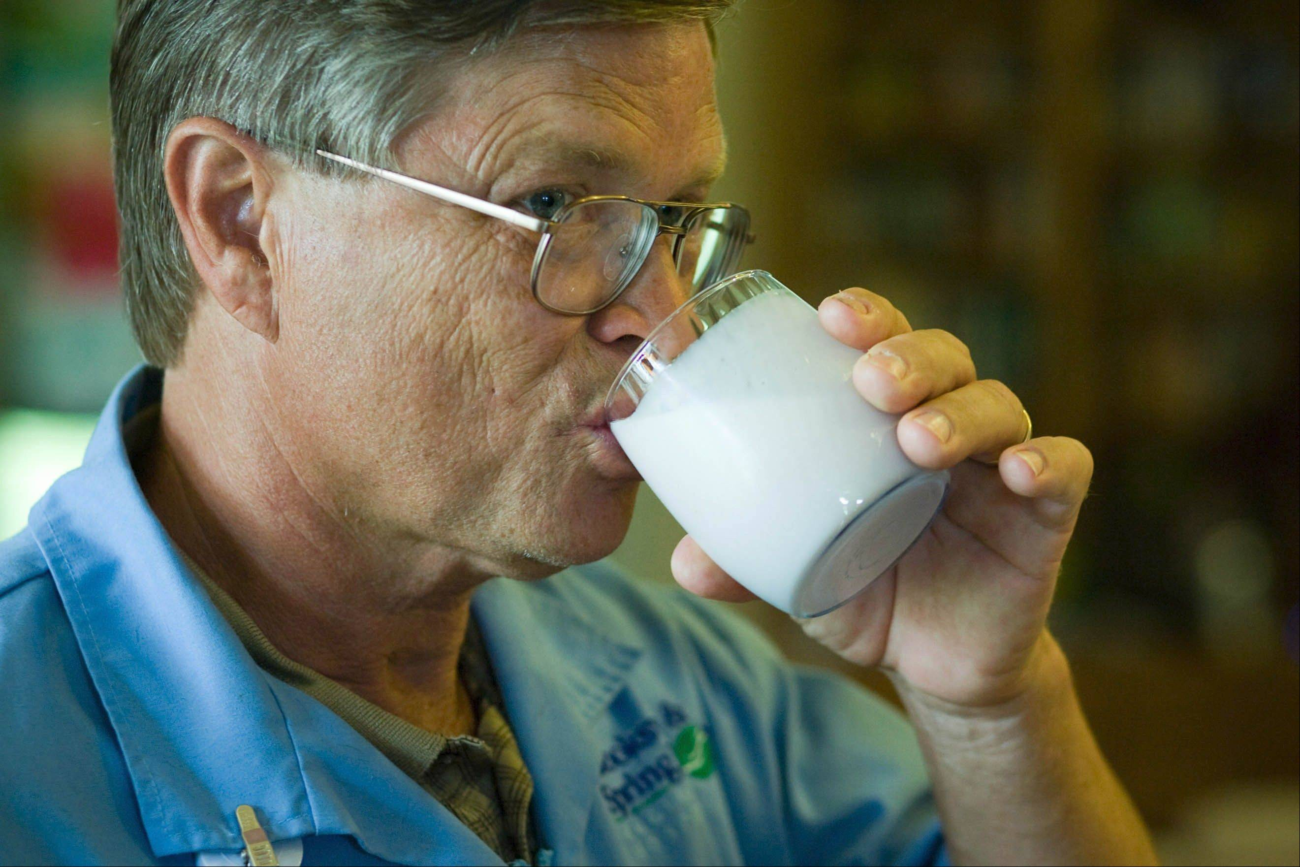 Steve Newport drinks a mixture of coconut oil and liquid yogurt at his home. The liquid yogurt is just one of several ways his wife, Dr. Mary Newport, has found to make the oils easier to consume.