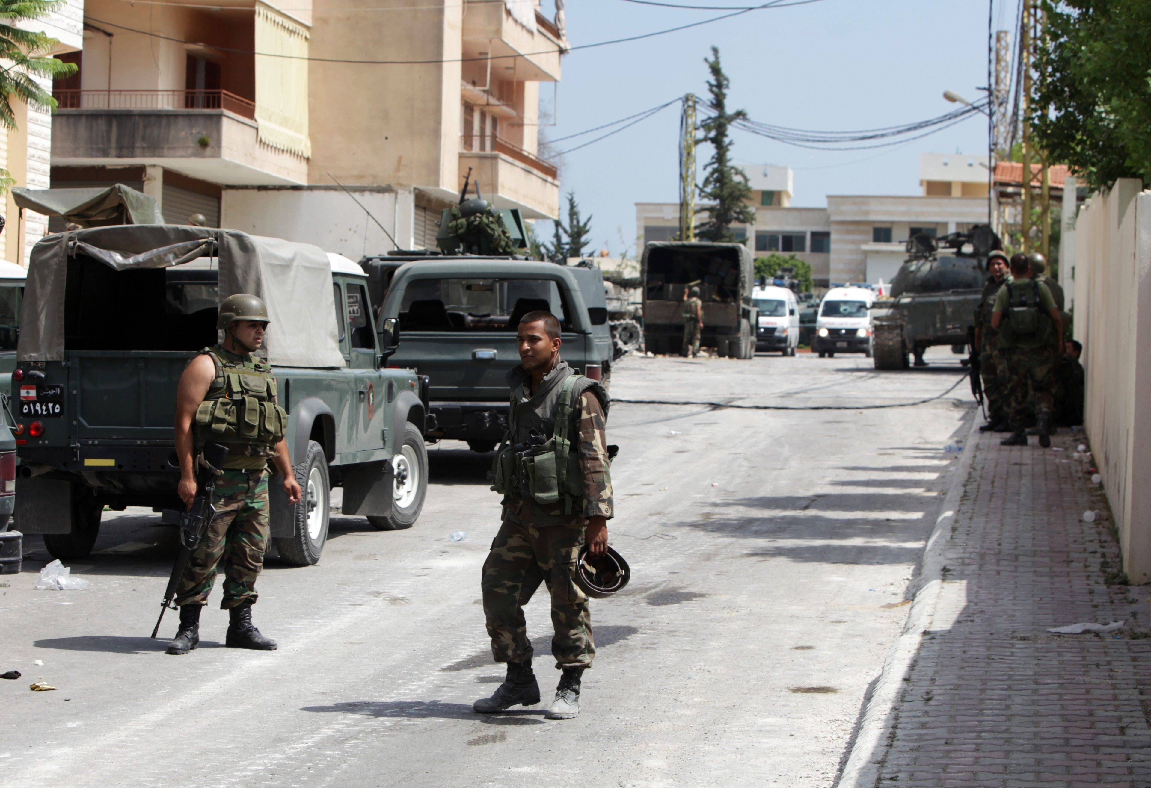 Lebanese Army soldiers monitor during clashes that erupted between followers of a radical Sunni cleric Sheik Ahmad al-Assir and Shiite gunmen in Sidon, Lebanon, Monday.