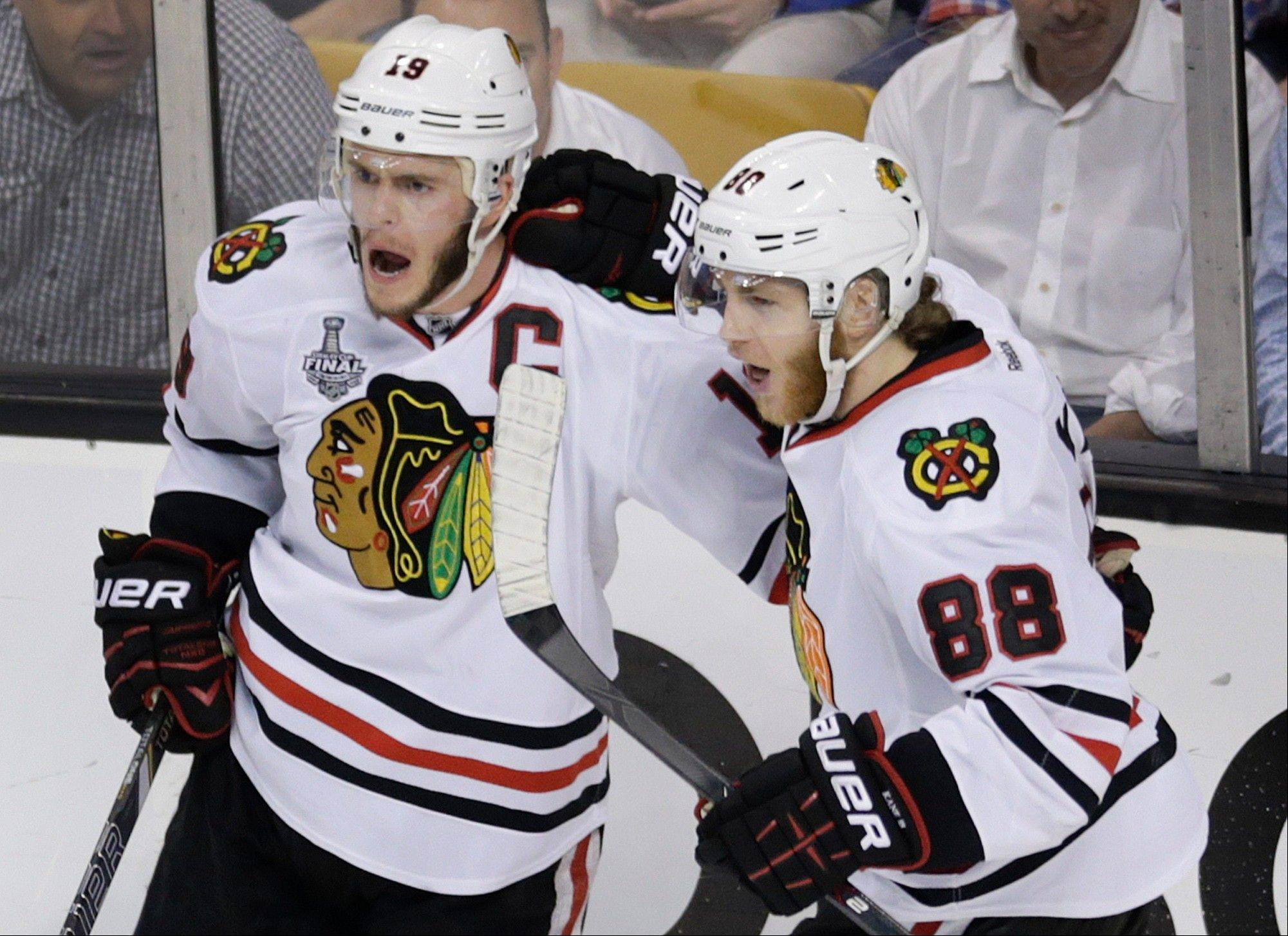 Blackhawks center Jonathan Toews celebrates his goal with winger Patrick Kane in Monday�s second period.