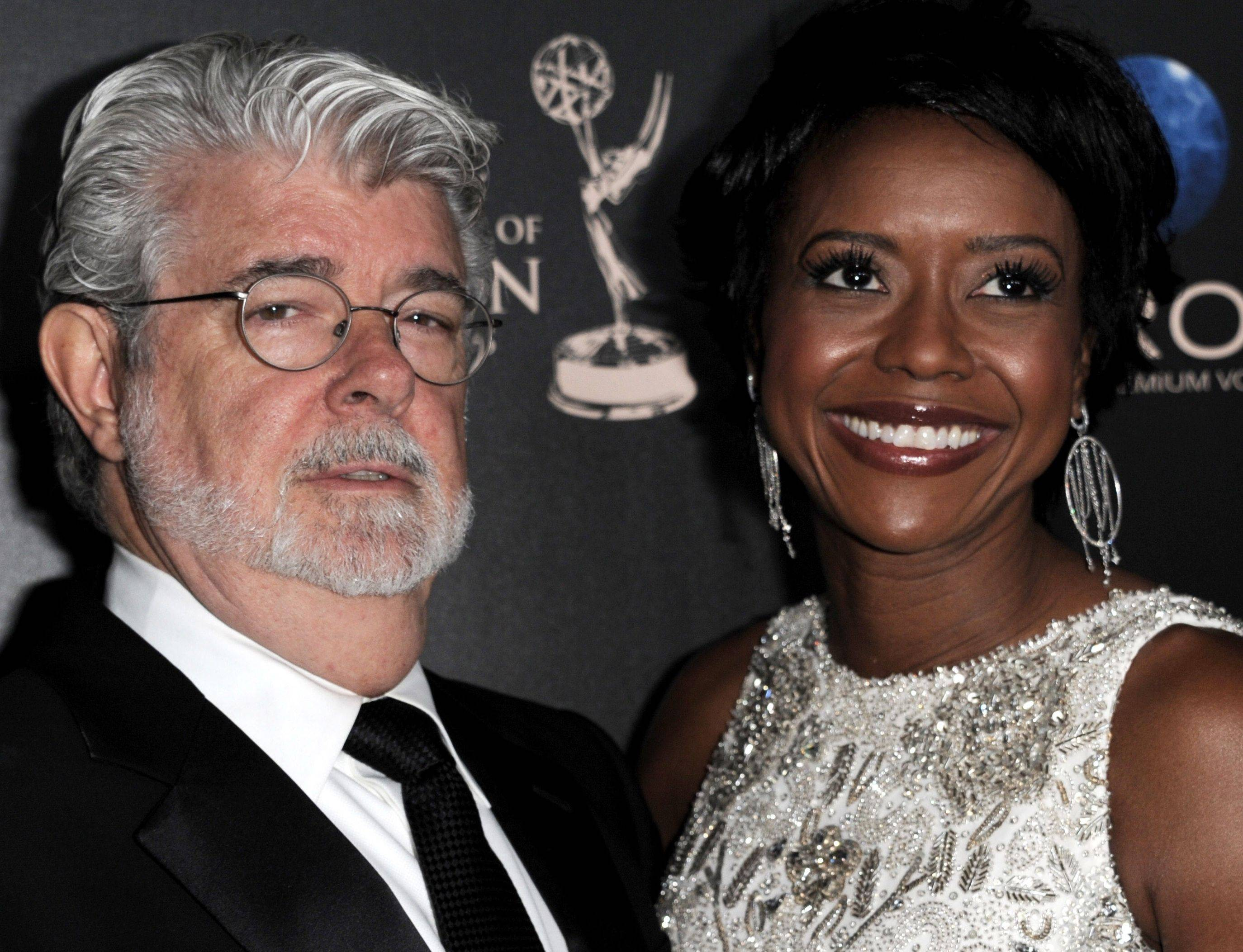 "In this June 16, 2013 file photo, George Lucas, left, and longtime girlfriend Mellody Hobson arrive at the 40th Annual Daytime Emmy Awards in Beverly Hills, Calif. A Lucasfilm spokeswoman on Monday confirmed the ""Star Wars"" creator married Hobson in a weekend ceremony at Skywalker Ranch north of San Francisco."