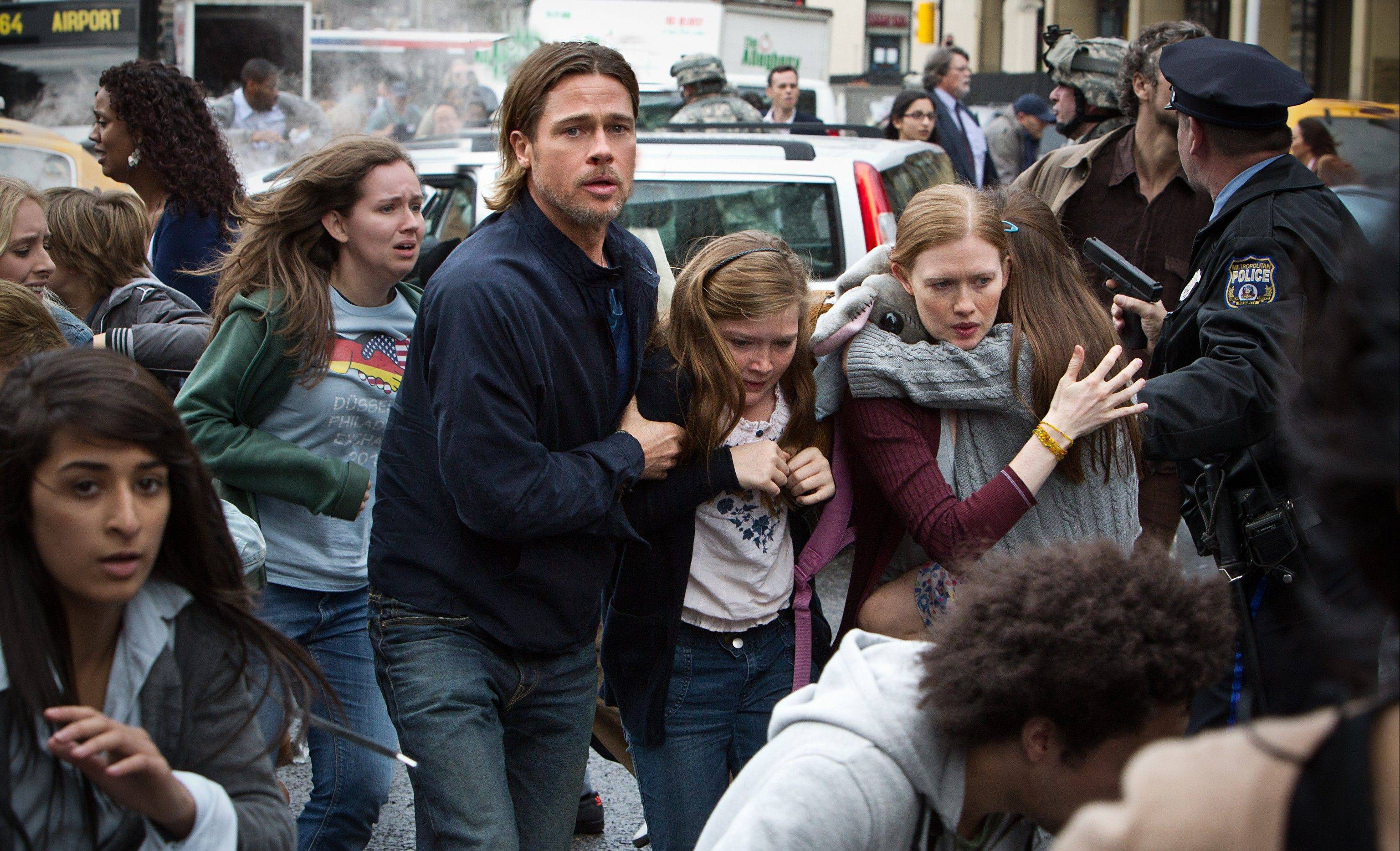 "Brad Pitt stars as retired U.N. investigator Gerry Lane in the action thriller ""World War Z."" A sequel and possibly a third installment of the film are expected."