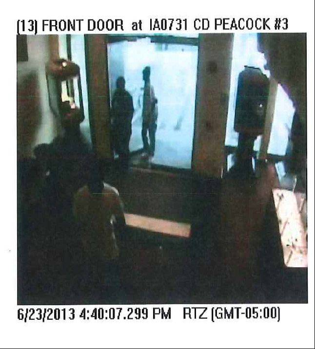 Police say this surveillance image shows three men who tried to rob the C.D. Peacock jewelry store Sunday at Oakbrook Center mall in Oak Brook. A store security guard shot one of the men while the other two fled, authorities said.