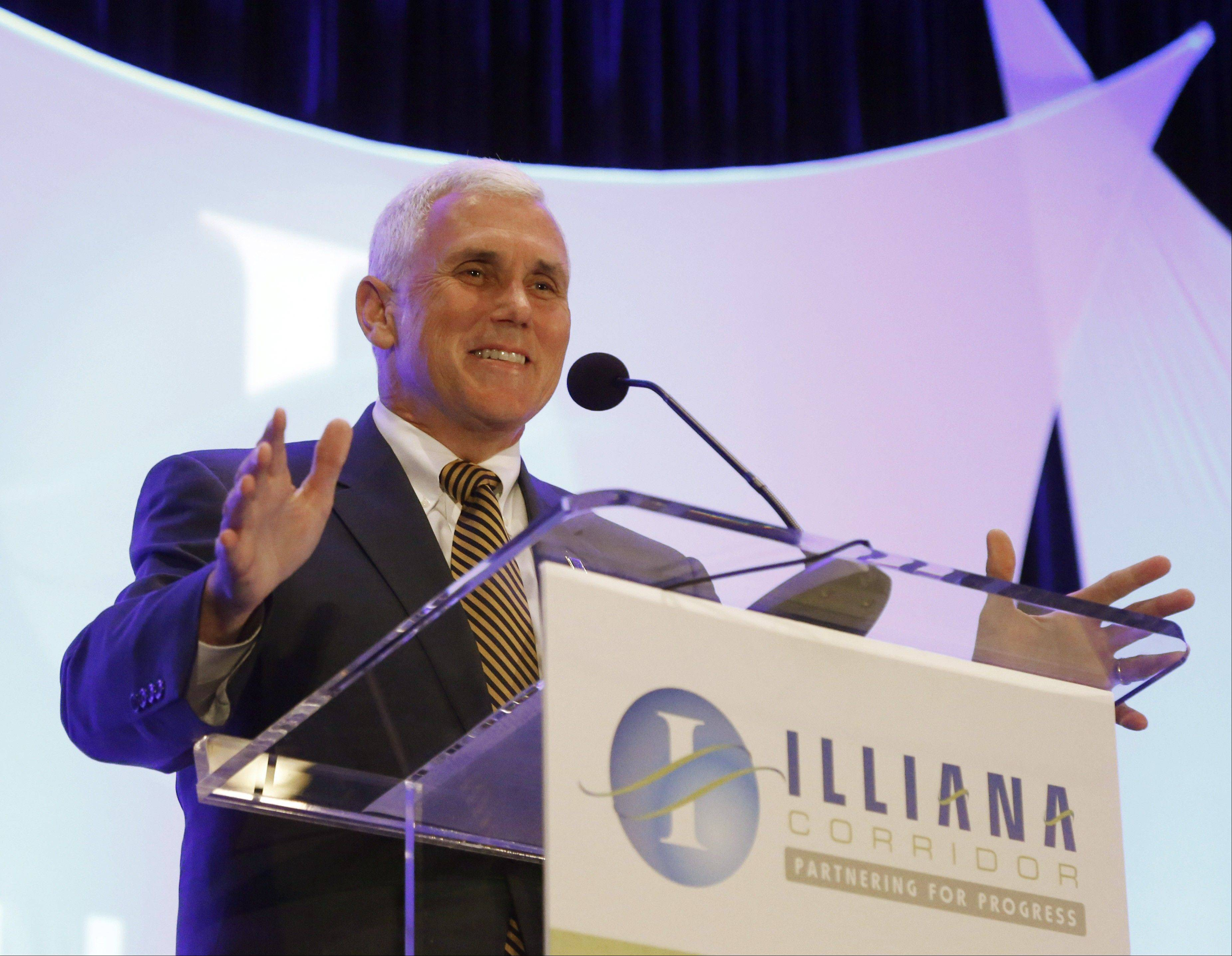 Indiana Gov. Mike Pence addresses the Illiana Industry Forum on Monday in Rosemont. Pence was joined by Illinois Gov. Pat Quinn at the event to promote a planned 47-mile expressway aimed at relieving traffic into the Chicago area.