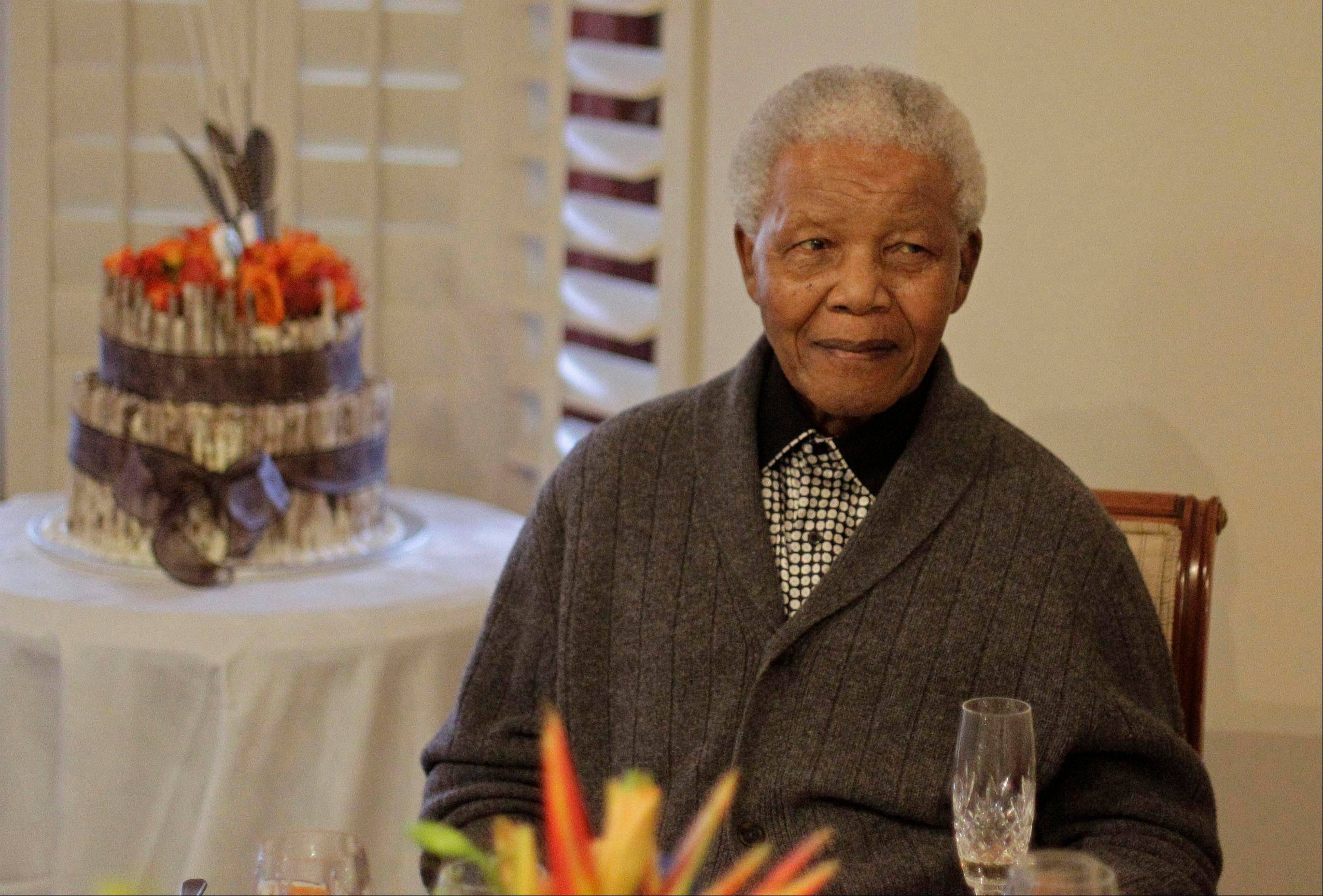 In this Wednesday, July 18, 2012 file photo, former South African President Nelson Mandela celebrates his 94th birthday with family in Qunu, South Africa.